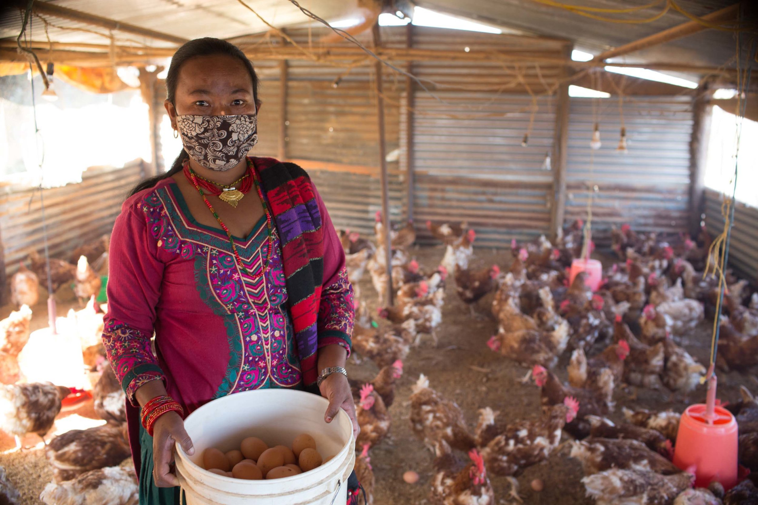 This woman was able to start a successful poultry farming business thanks to training and a small loan from her self-help group.