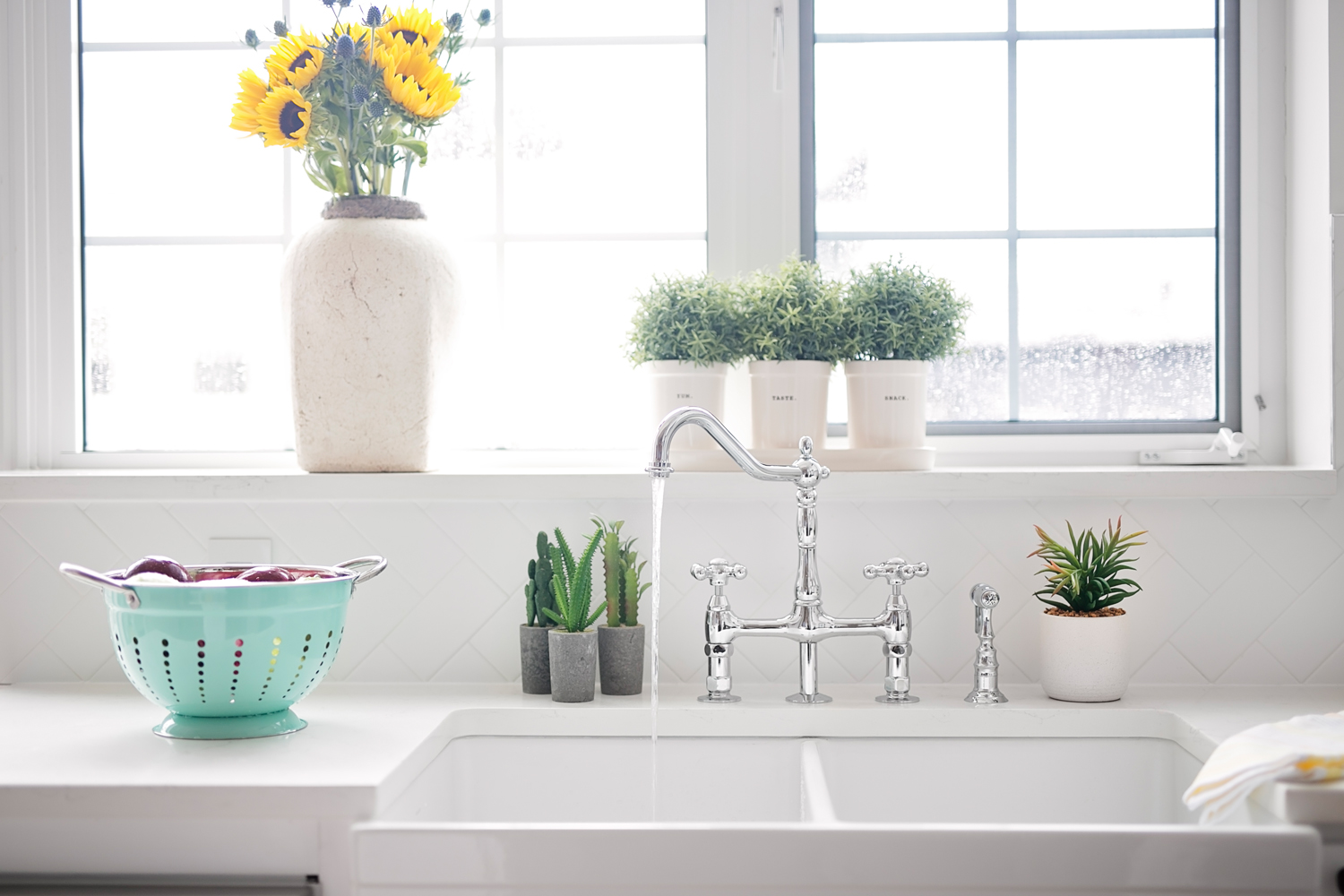 The window in this kitchen is amazing as it adds a focal design point where natural light fills the room. The sill becomes a lovely place to plant herbs or hold your favorite vase of sunflowers.