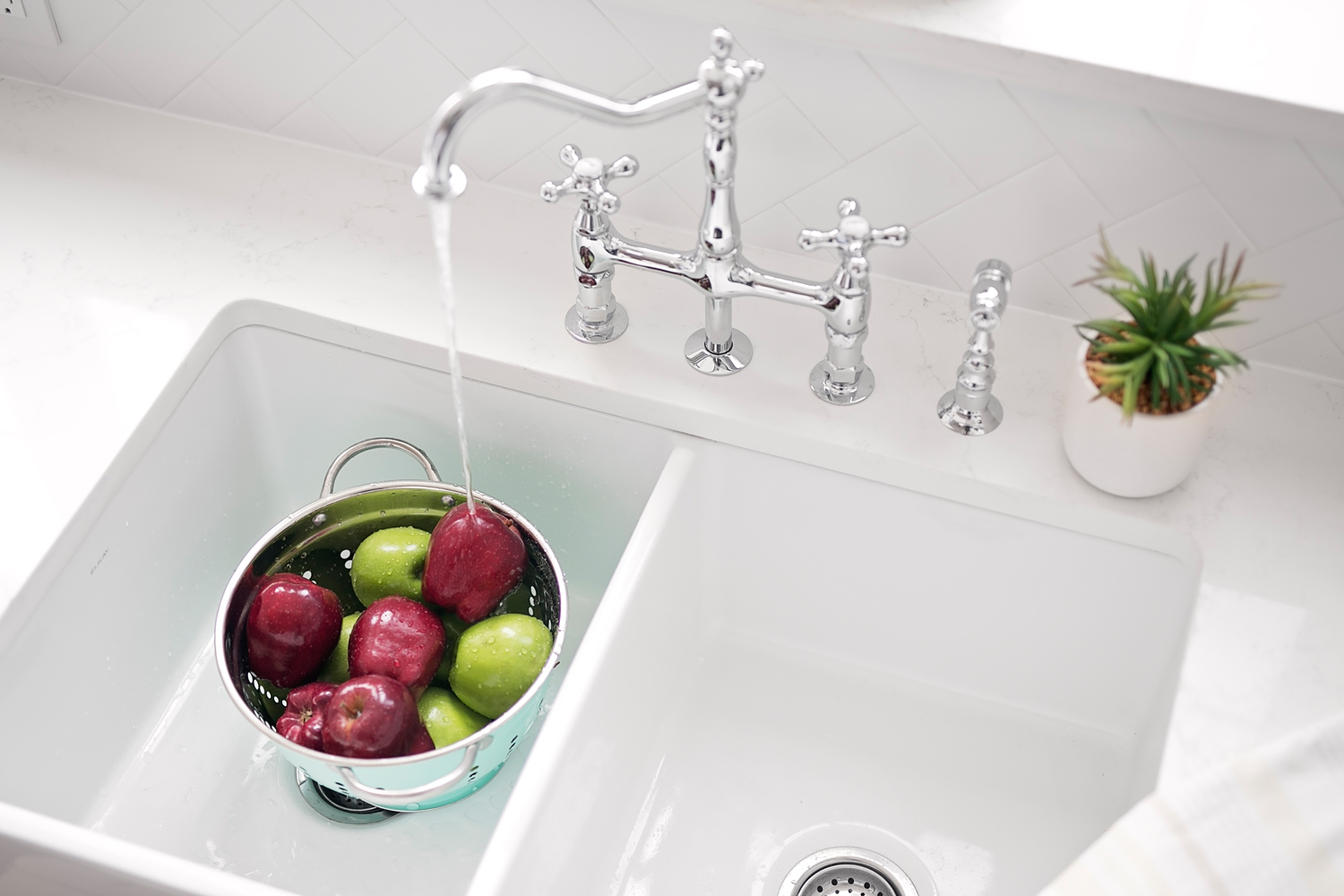 Long beloved for their visual appeal and ergonomic functionality, the farmhouse sink is a go-to choice in contemporary kitchen design. Also known as apron sinks, or apron front sinks, these large kitchen basins were often found in rural homes of decades past.  They were originally designed for comfort; for people who spent long hours at the sink, ergonomics were important – the apron front's forward orientation eliminated the countertop that caused them to lean forward and strain more than necessary.