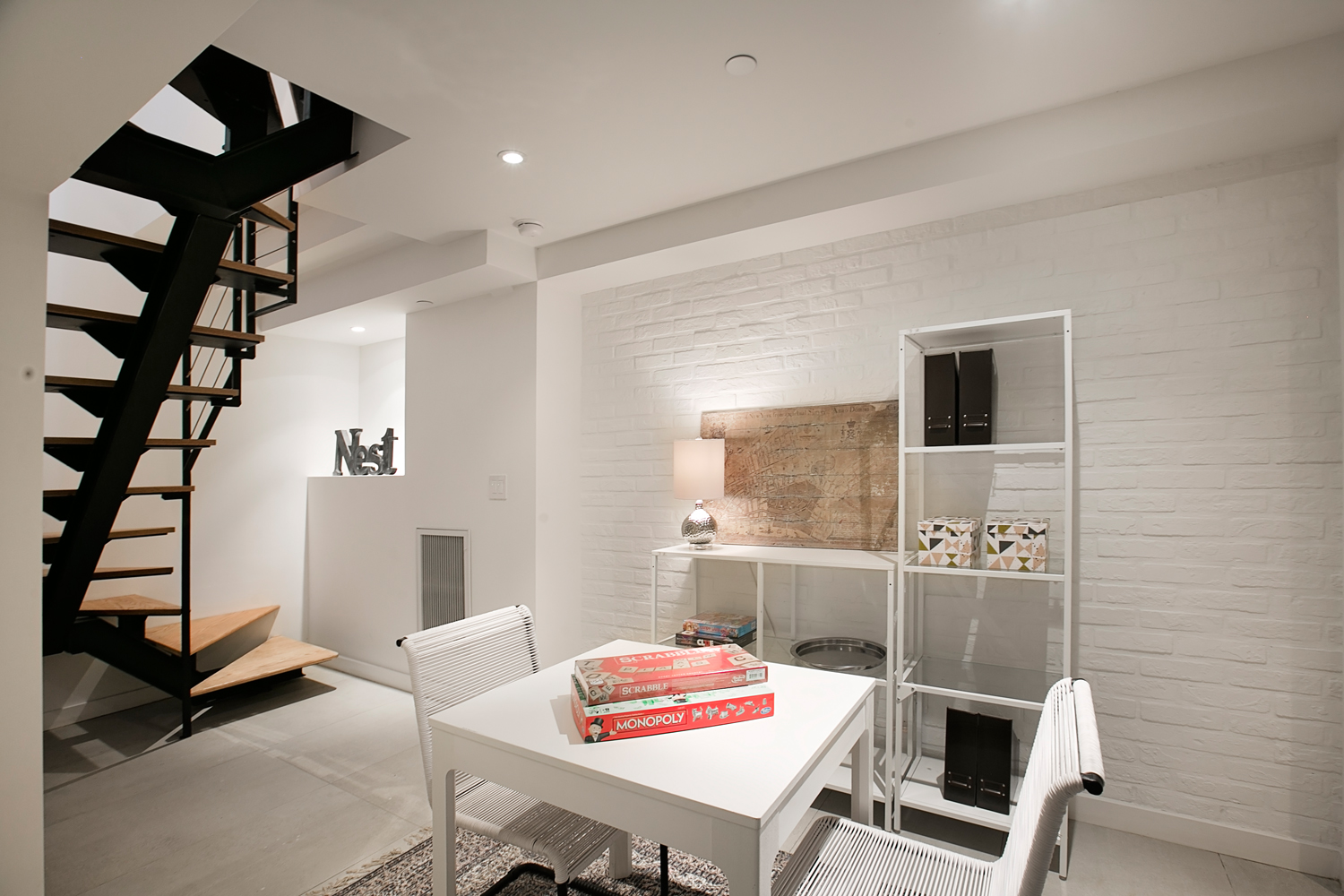 the rec room - The lower level is a versatile space to create your perfect works, play, or hang-out space.