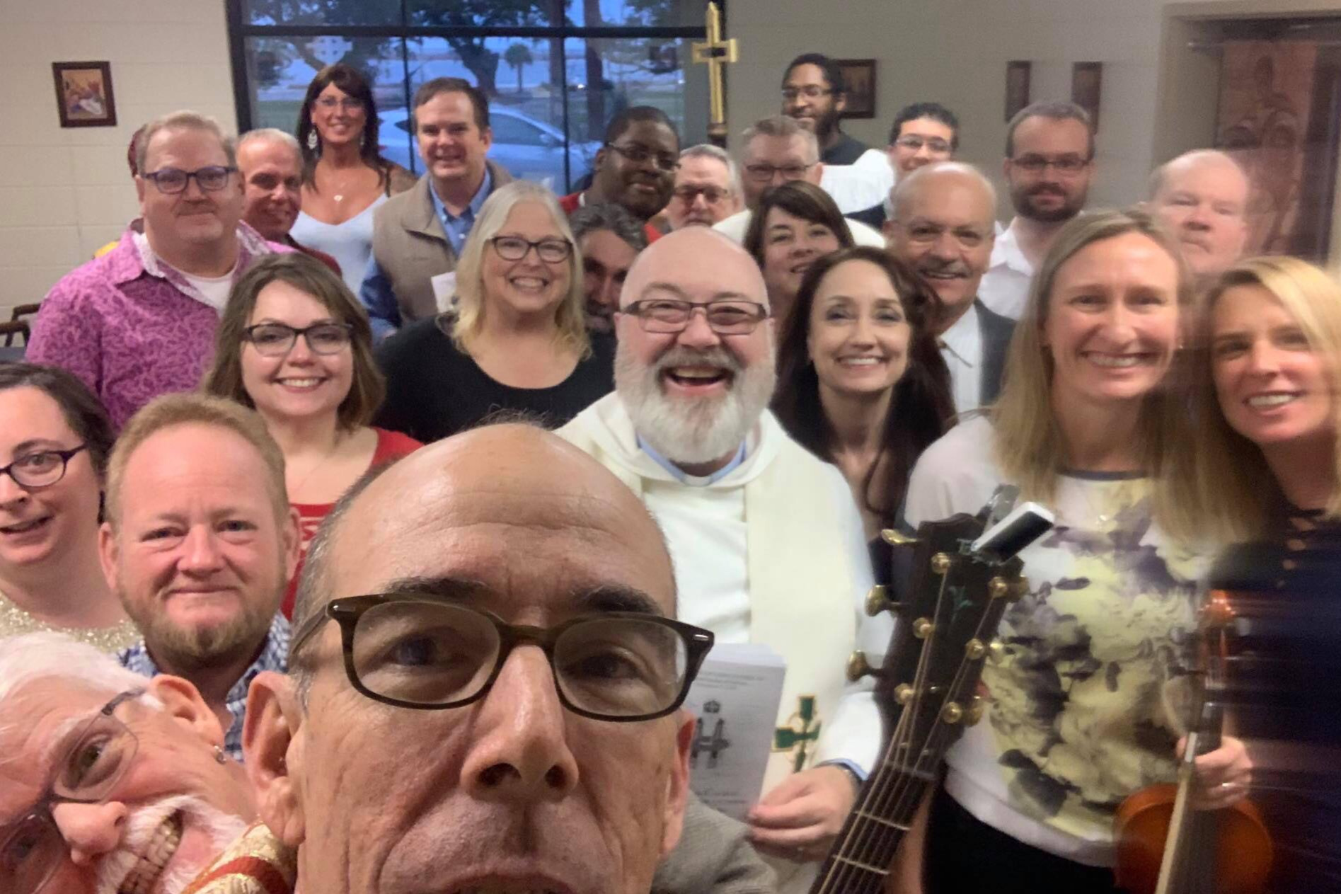 The Rt Rev Brian R. Seage, Bishop of Mississippi, takes a group selfie during his episcopal visitation to Lighthouse-St. Nicholas, 9 December 2018.