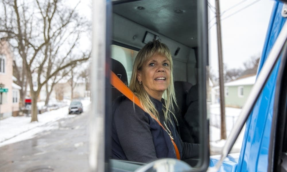 Photo credit:  Evan Frost  |  MPR News   City of Minneapolis winter maintenance driver Vicky Stitch sits in the driver's seat of her snow plow in Minneapolis Dec. 11. Evan Frost | MPR News