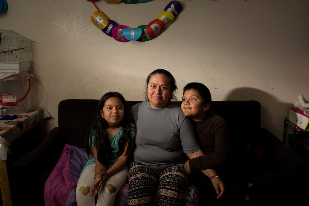 Domitila Valerio with her children, Esmeralda, 9, and Diego, 7, at their home in the Little Village neighborhood of Chicago.  Michelle Kanaar for APM Reports