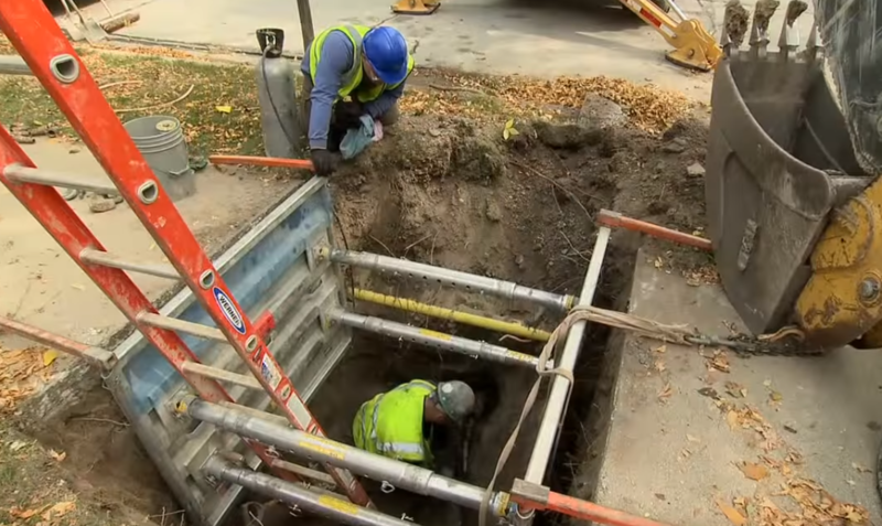 Milwaukee Water Works employees repair city pipes.  Screenshot/YouTube/Milwaukee Water Works