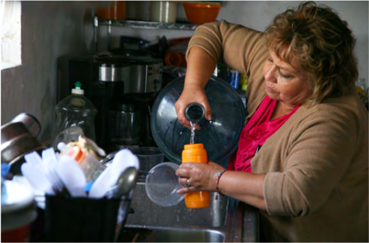In California's Central Valley, many vulnerable communities rely on bottled water due to inadequate infrastructure and water quality challenges.  Photo credit: Community Water Center