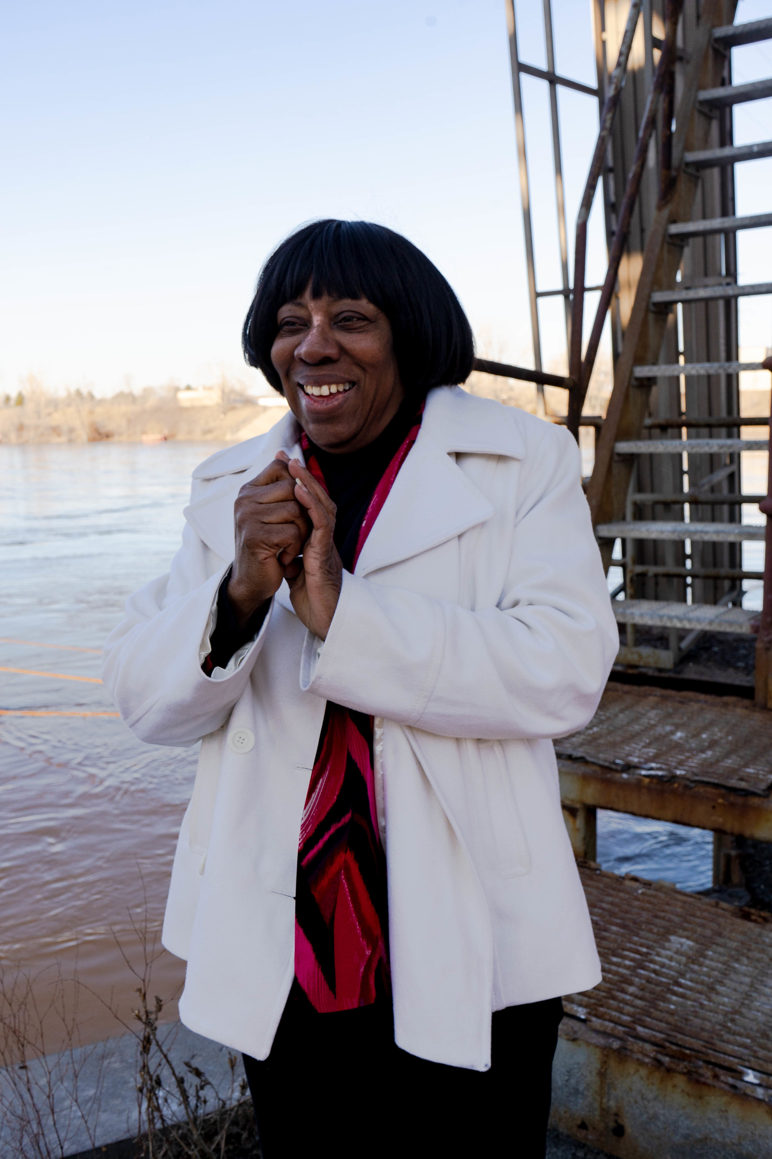 Catherine Fleming stands by of the Mississippi River for a portrait at the Upper Harbor Terminal site.