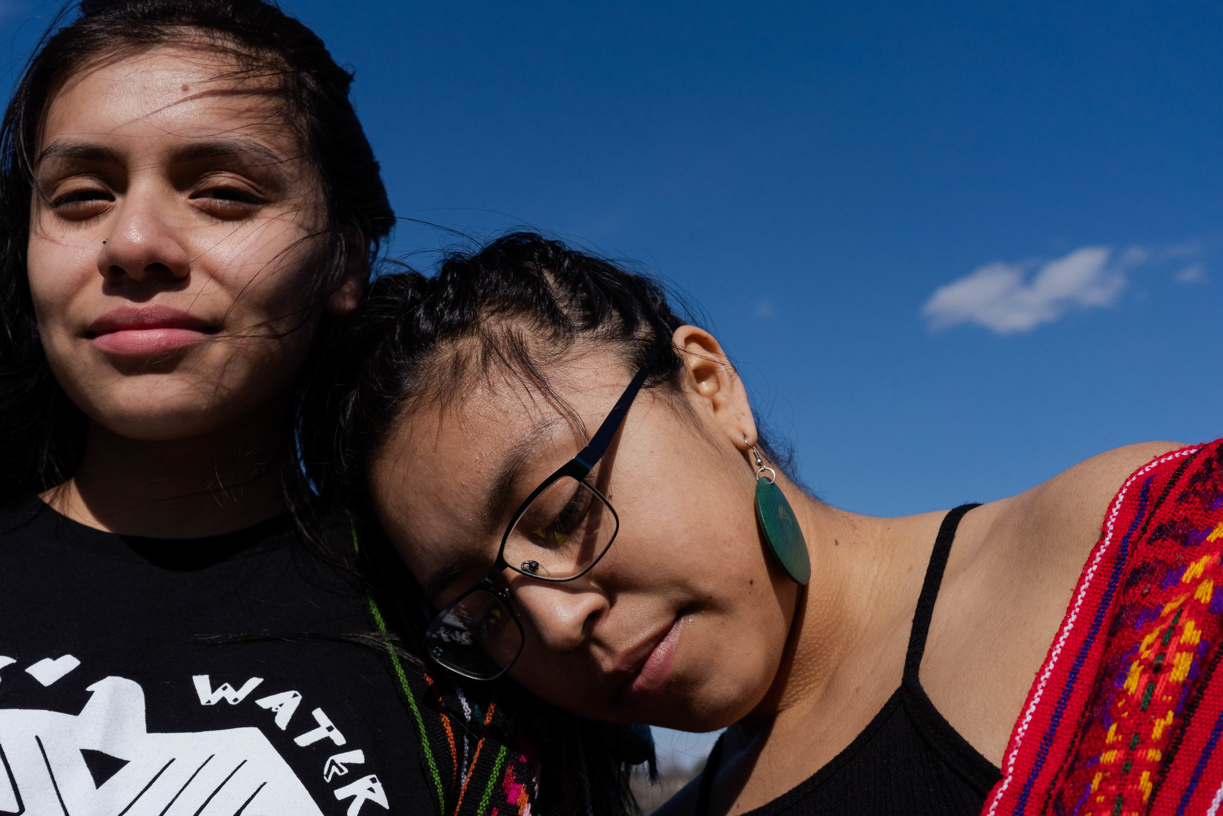 Amoreina Espinosa (left) and Reyna Day (right) stand for a portrait at Lake Phalen.  Photo by Iyana Esters | The Water Main