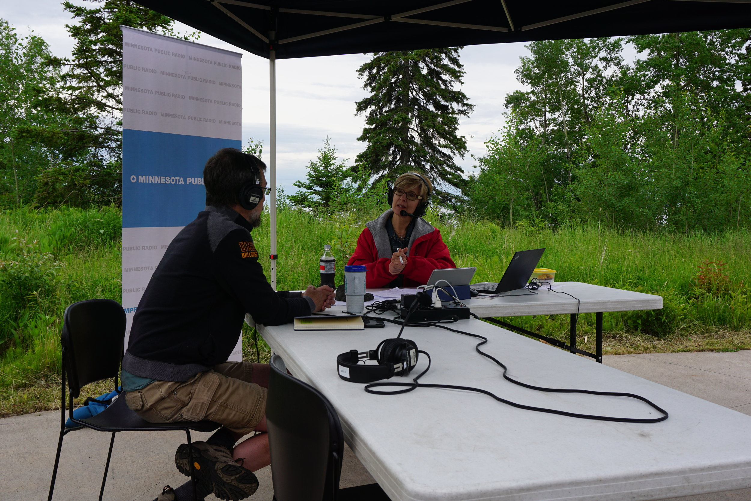 Morning Edition host Kathy Wurzer conducts an interview at Tettegouche State Park on the shore of Lake Superior.  Lauren Humpert   The Water Main