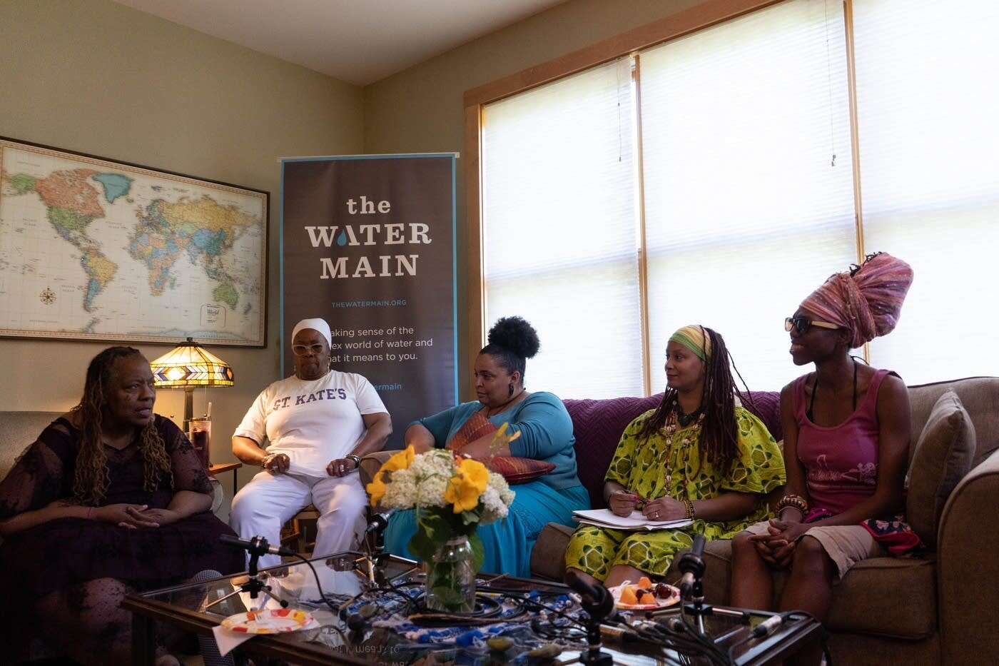 Amoke Kubat, left, and her Yo Mama peers discuss their connection to water through motherhood hosted by MPR Water Month at St. Jane's House in Minneapolis on July 11, 2019. From left: Kubat, Rosanna Audgins, Sarah Penn, Leslie Harris, and ShaVunda Brown.  Iyana Esters | The Water Main