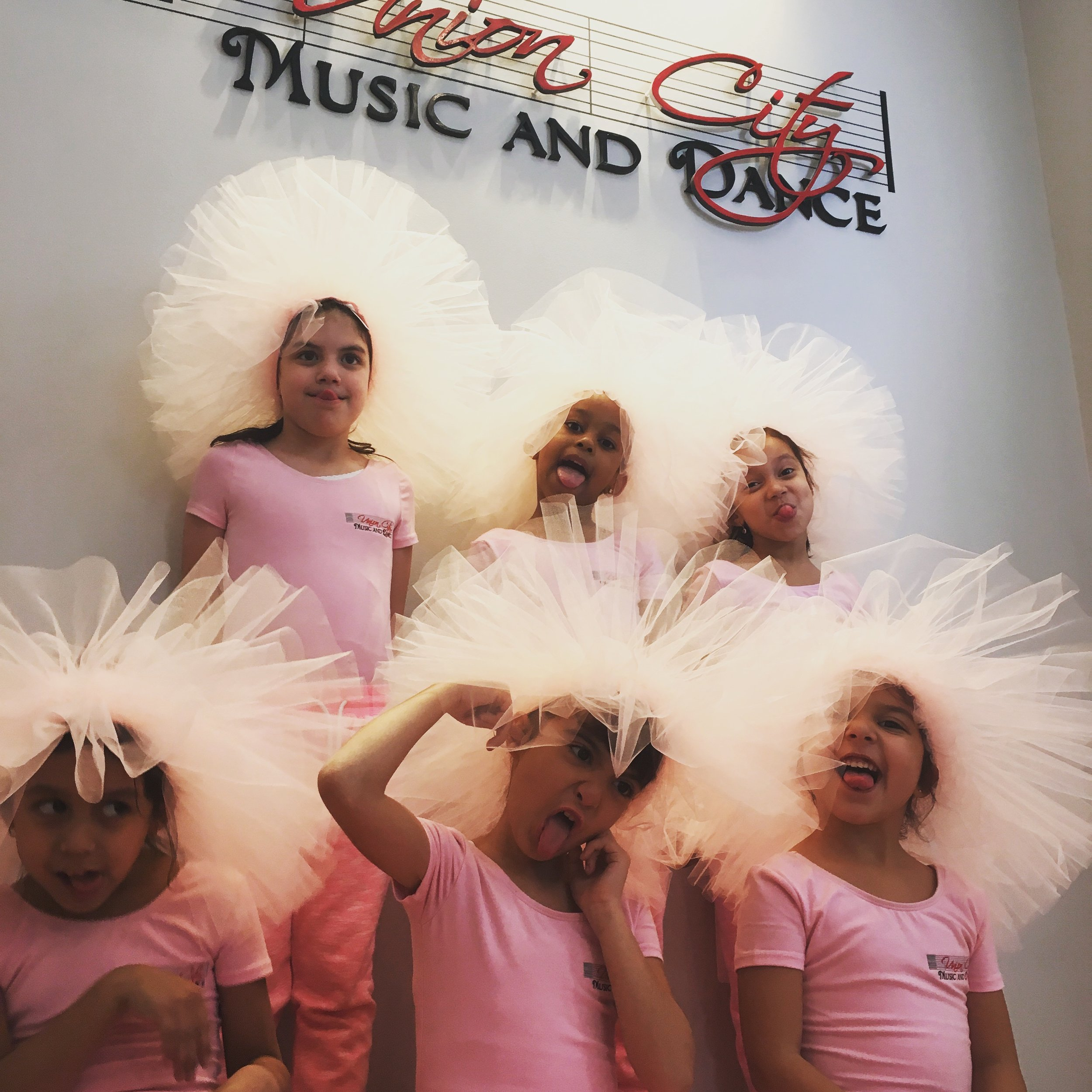Tutu Tots ages 2-5yrs - Our tutu-tots program is an intro to dance designed to support the exploration of dance in young students. This course covers beginnings of ballet, creative movement, gymnastics and flexibility.