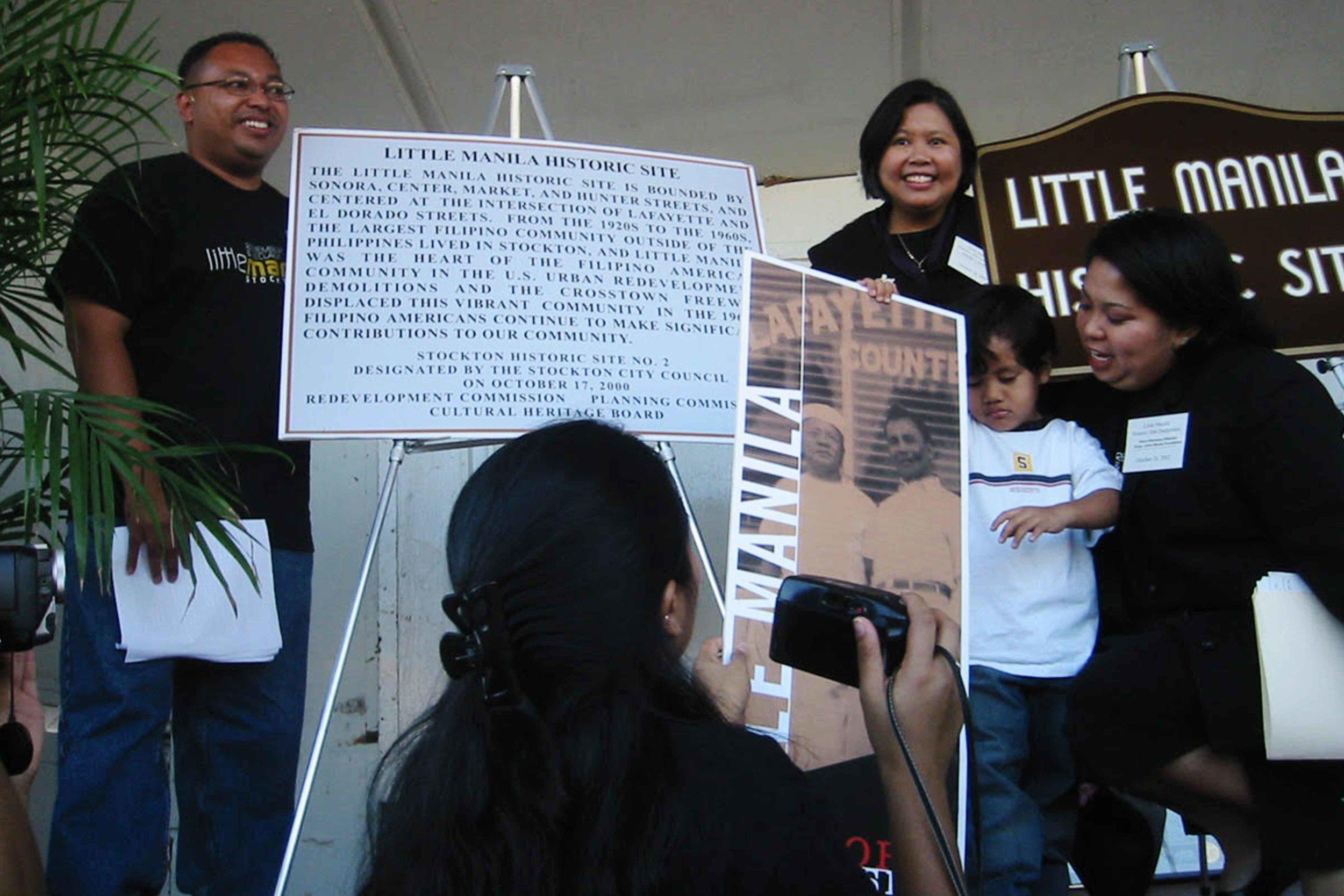 Little Manila Rising co-founders Dillon Delvo (far left) and Dawn Bohulano Mabalon (far right) at the dedication event for the Little Manila Historic Site in Stockton, California. Courtesy of Dillon Delvo.
