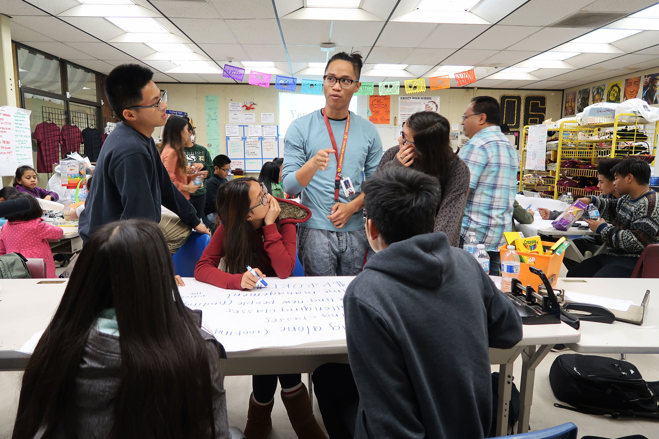 Little Manila Rising arts director Brian Batugo (center) teaches a group of students at the Little Manila After School Program at Edison High School in Stockton, California. Photo by Patrick Epino.