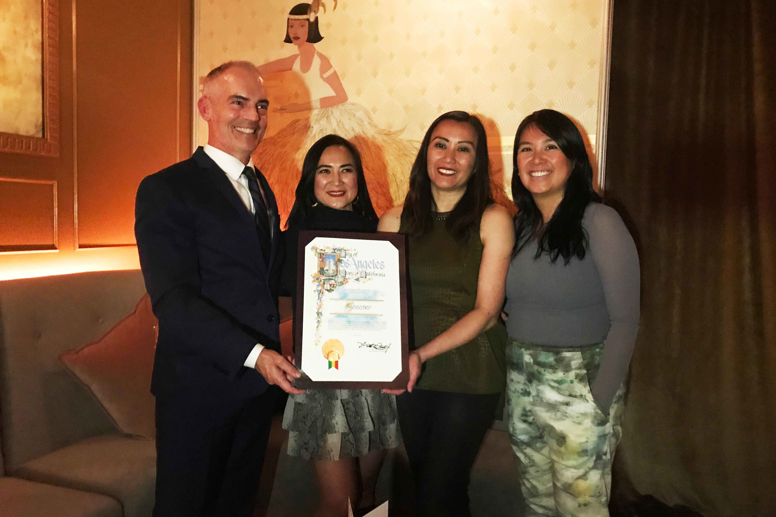 """Councilmember Mitch O'Farrell presents the City Certificate of Recognition to Genever owners Christine """"Tinette"""" Sumiller, Patricia """"Tricia"""" Perez, and Roselma Samala. Photo by Paola Mardo."""