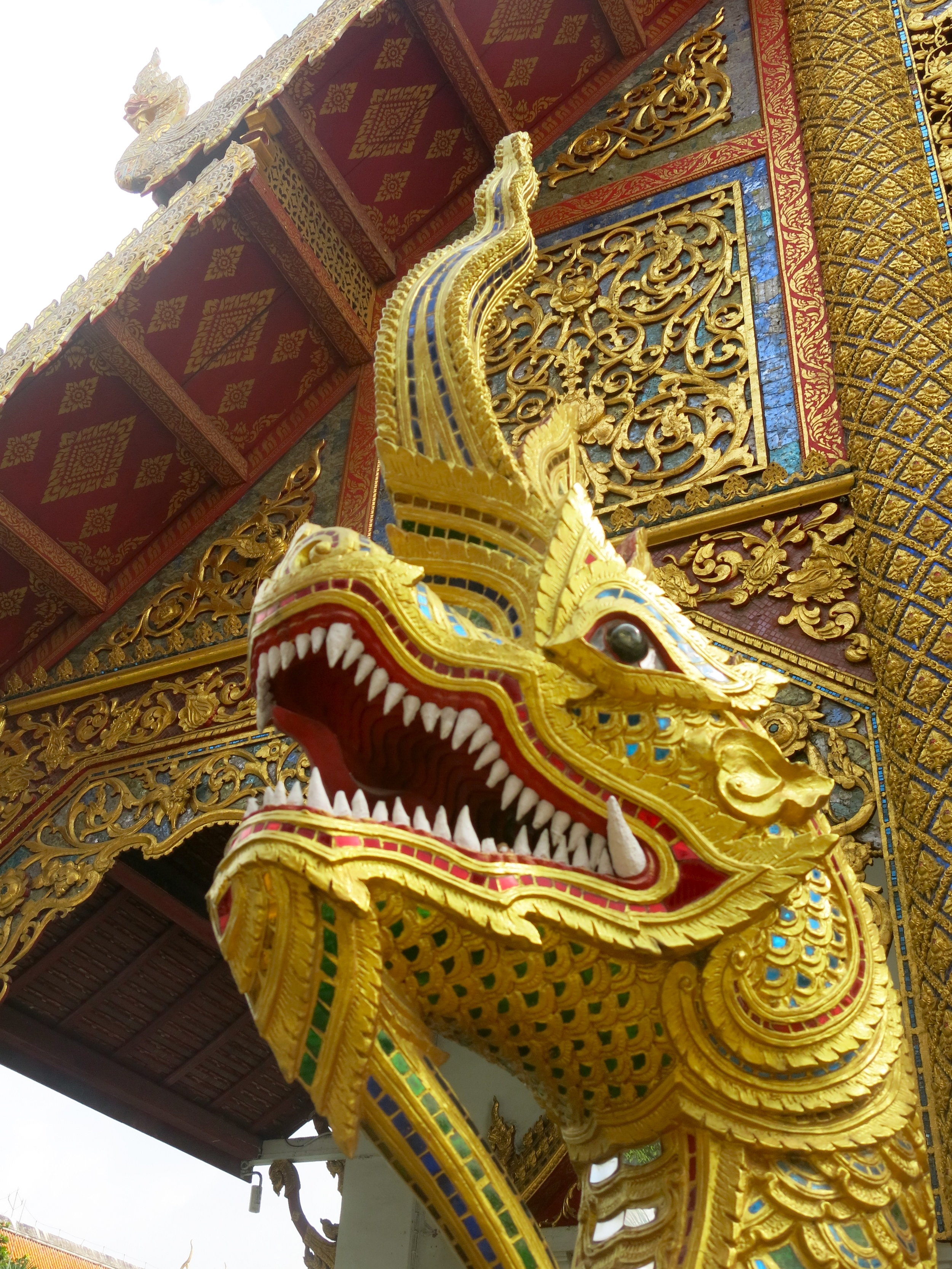 A golden Naga, a dragon-like figures guarding Buddhist temples