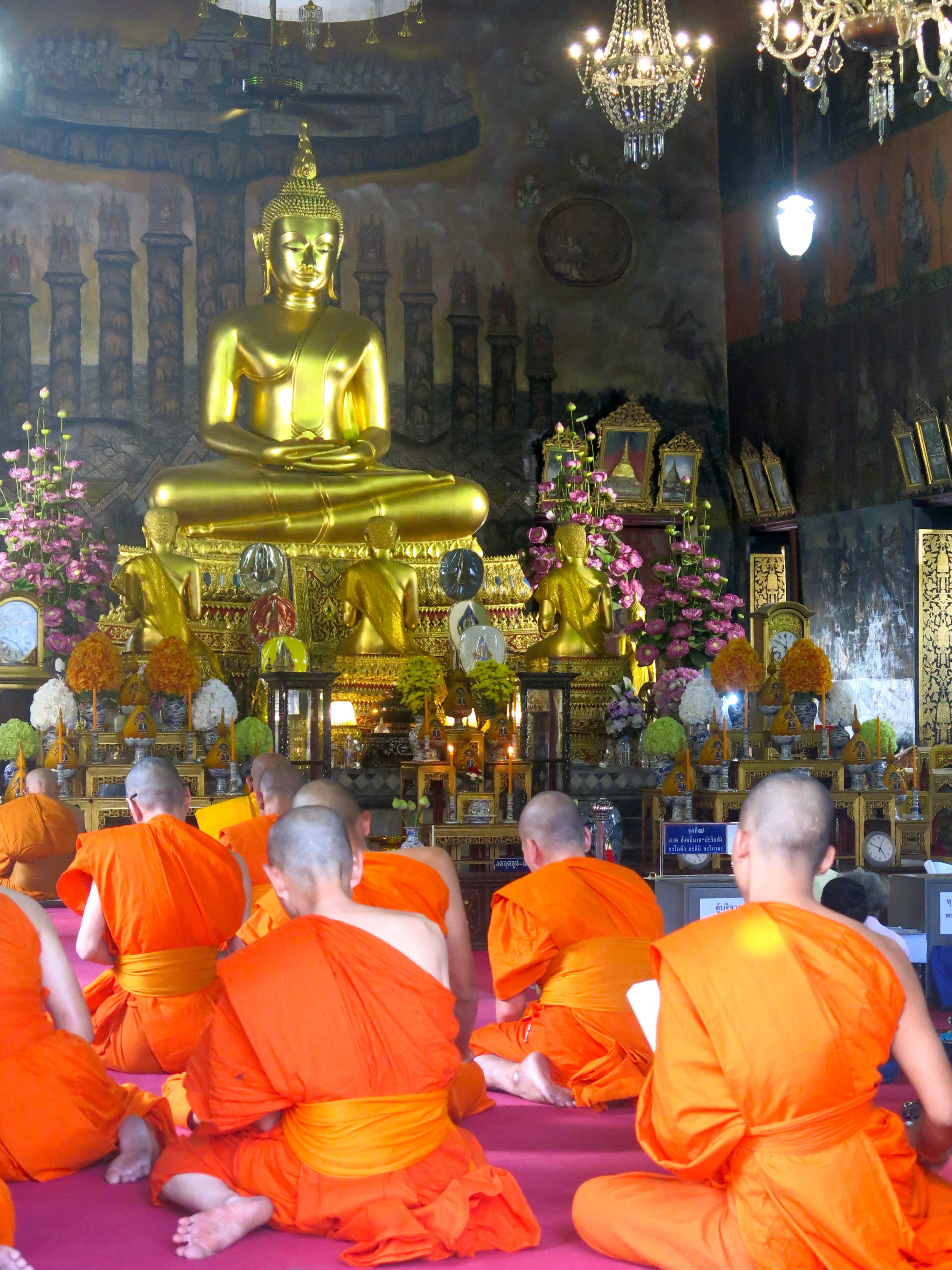 Buddhist monks praying together in the Wat Rakhang temple