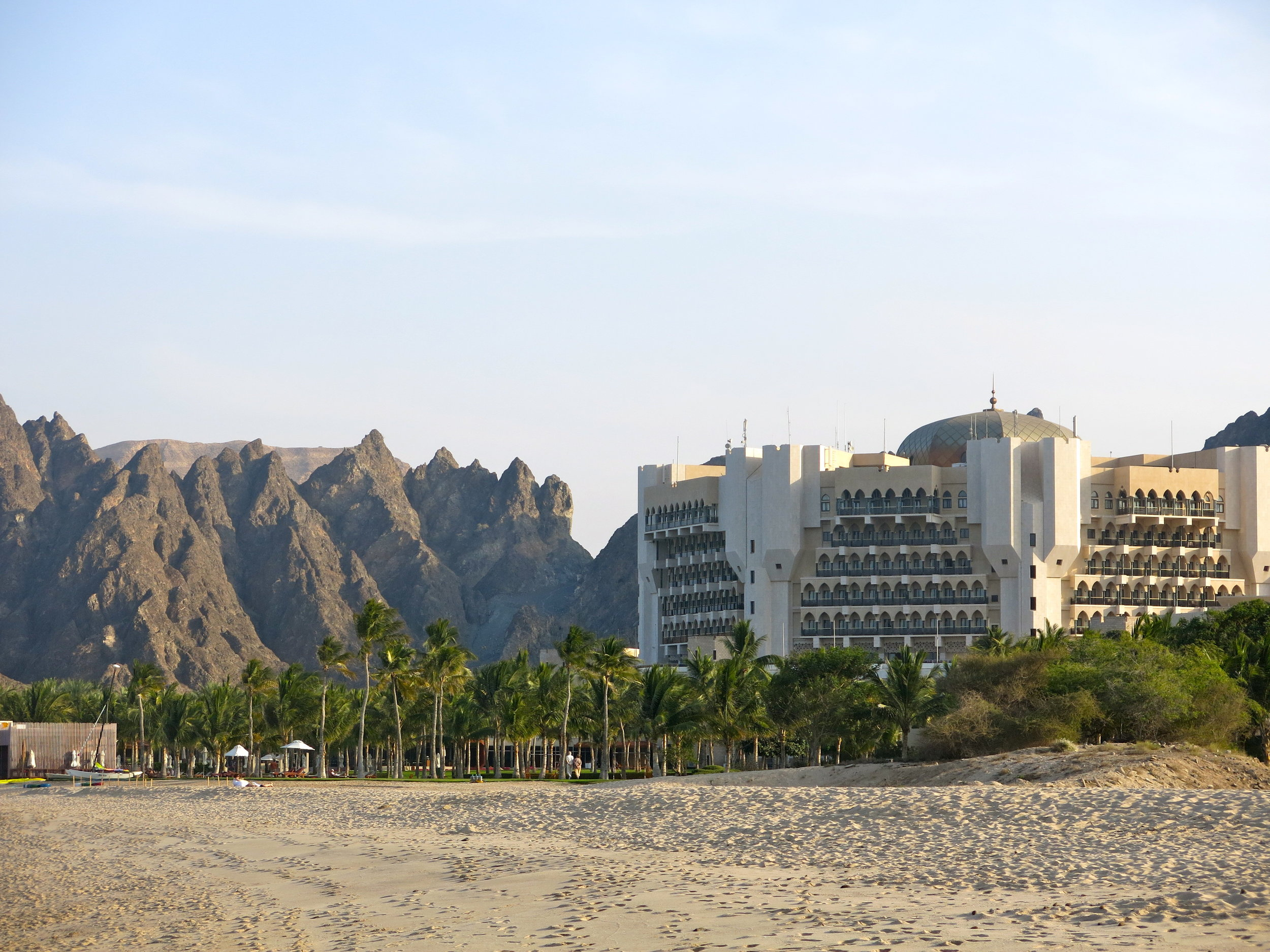 The Al-Bustan palace has its own sandy beach and a private garden full of palm trees