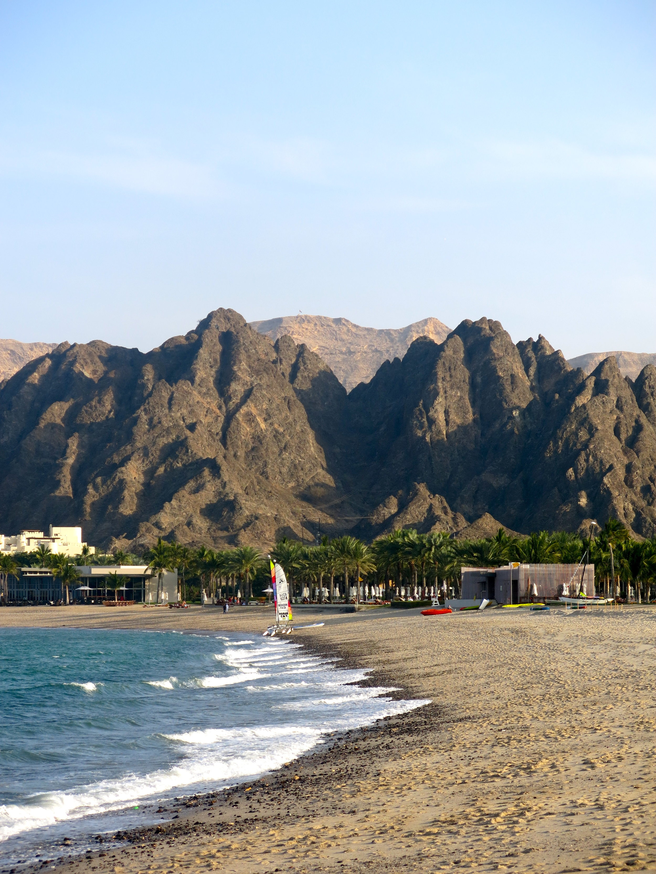 Dreamy rocky mountains encircle the bay of the Al-Bustan palace