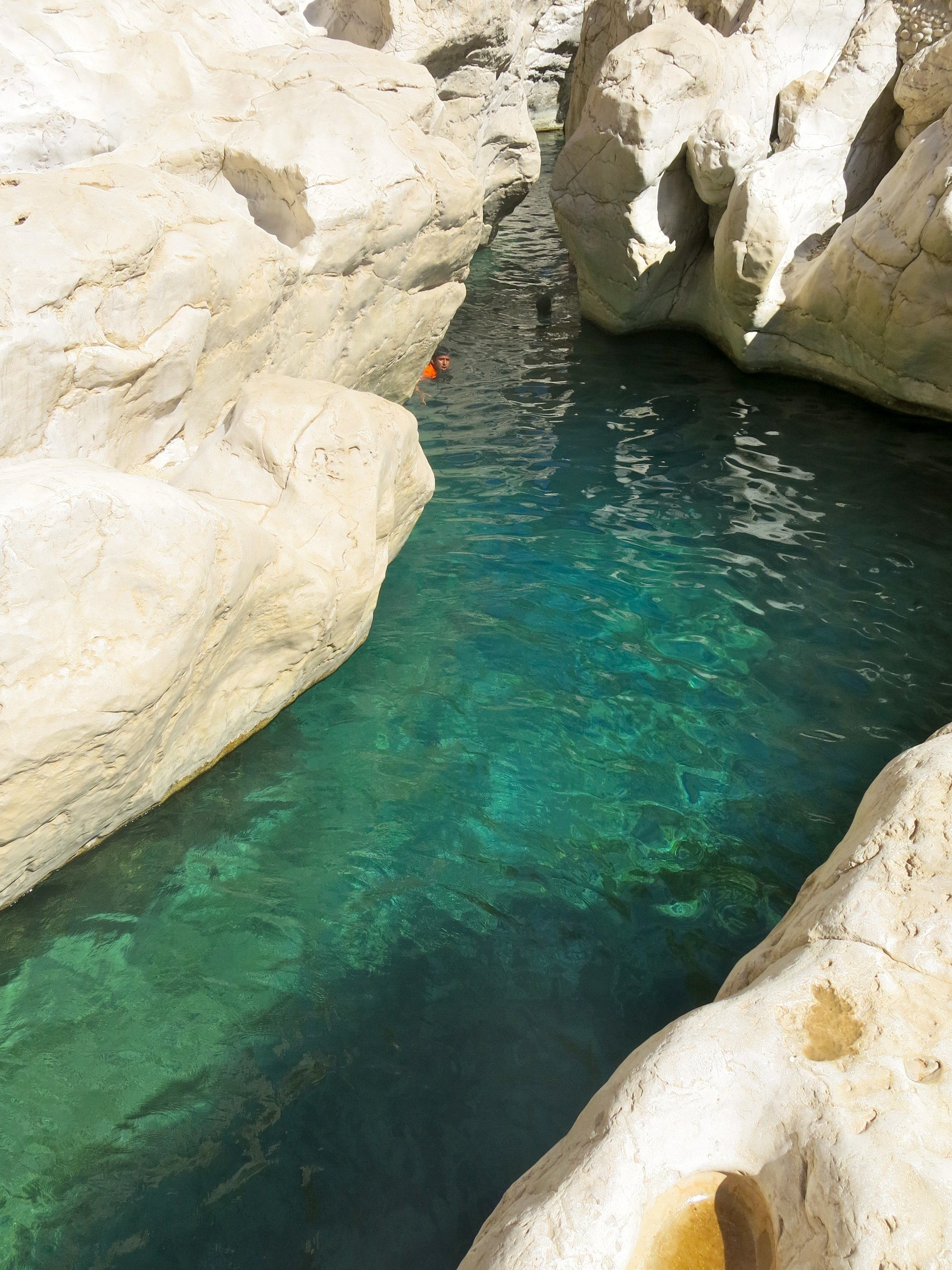 The turquoise clear water of Wadi Bani Khalid