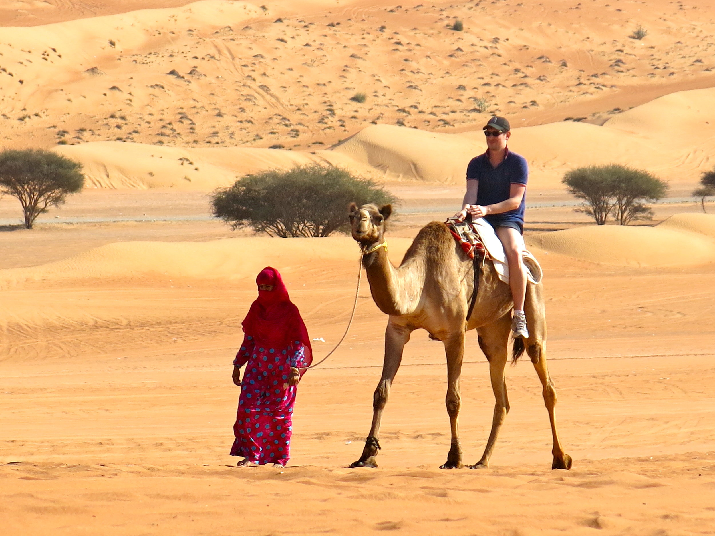 Camel ride with a Beduin woman in the Wahiba Sands desert