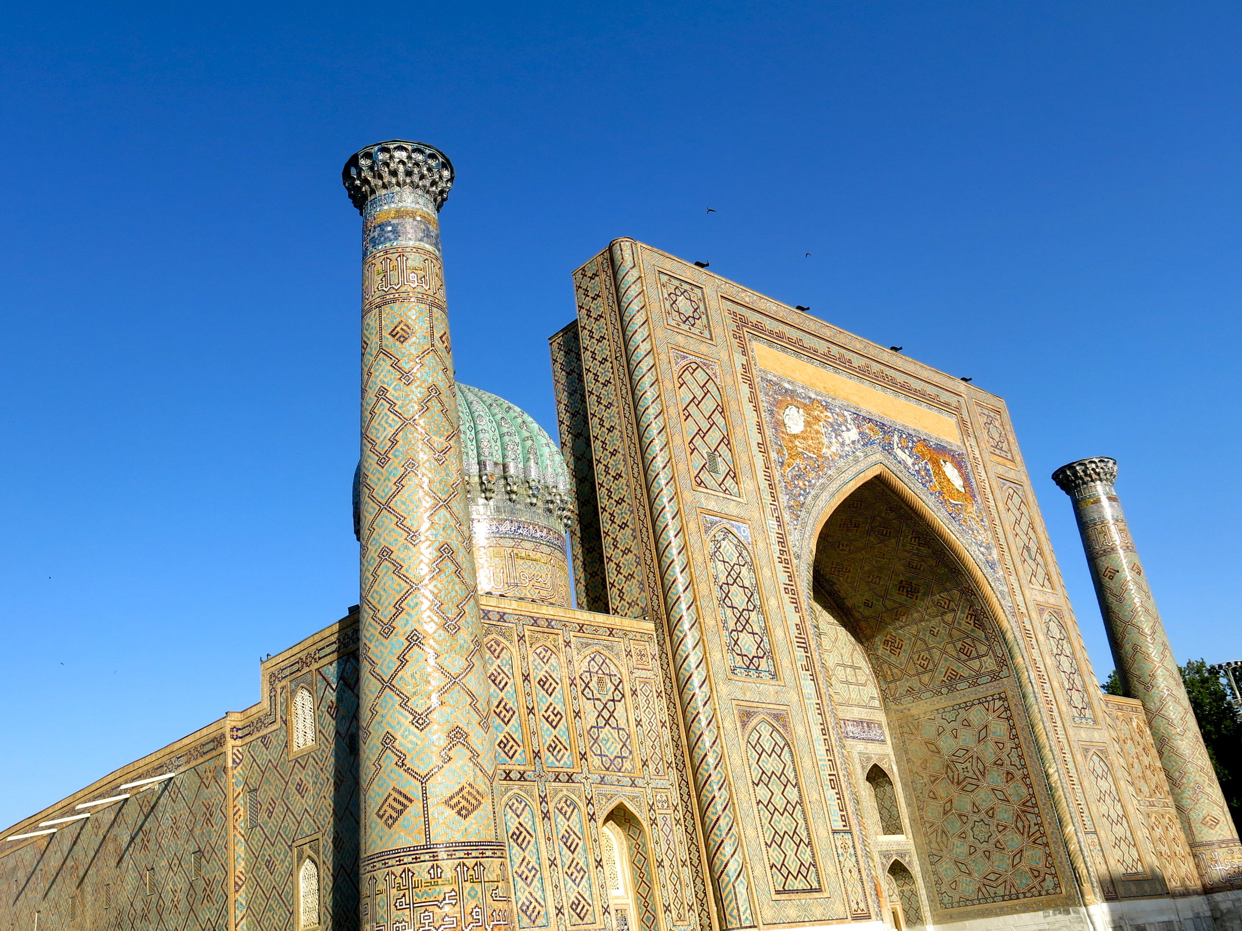 The beautiful Sher-Dor madrasa magnified by the sun