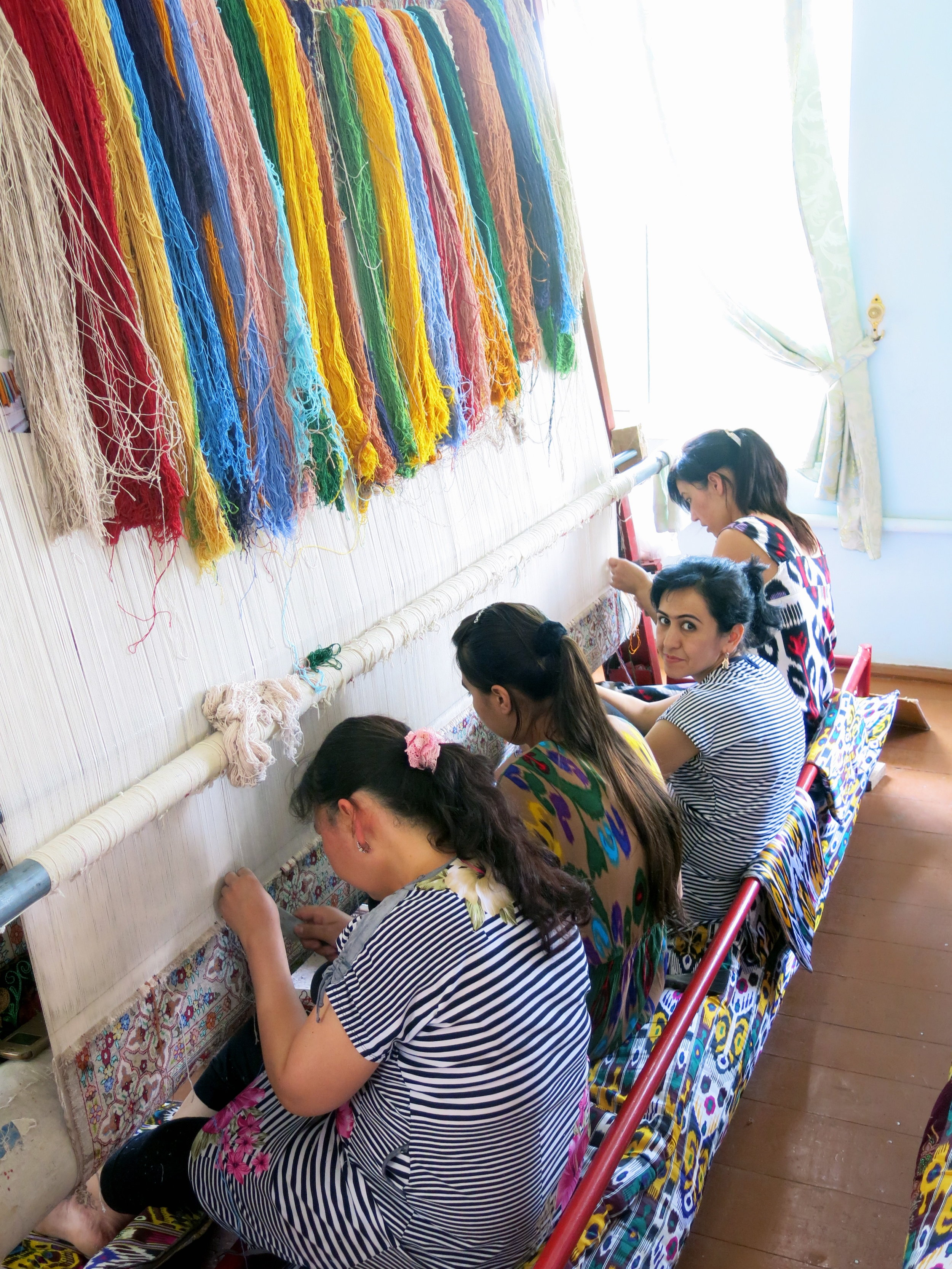 Weaving silk carpet is a an art of patience for these women