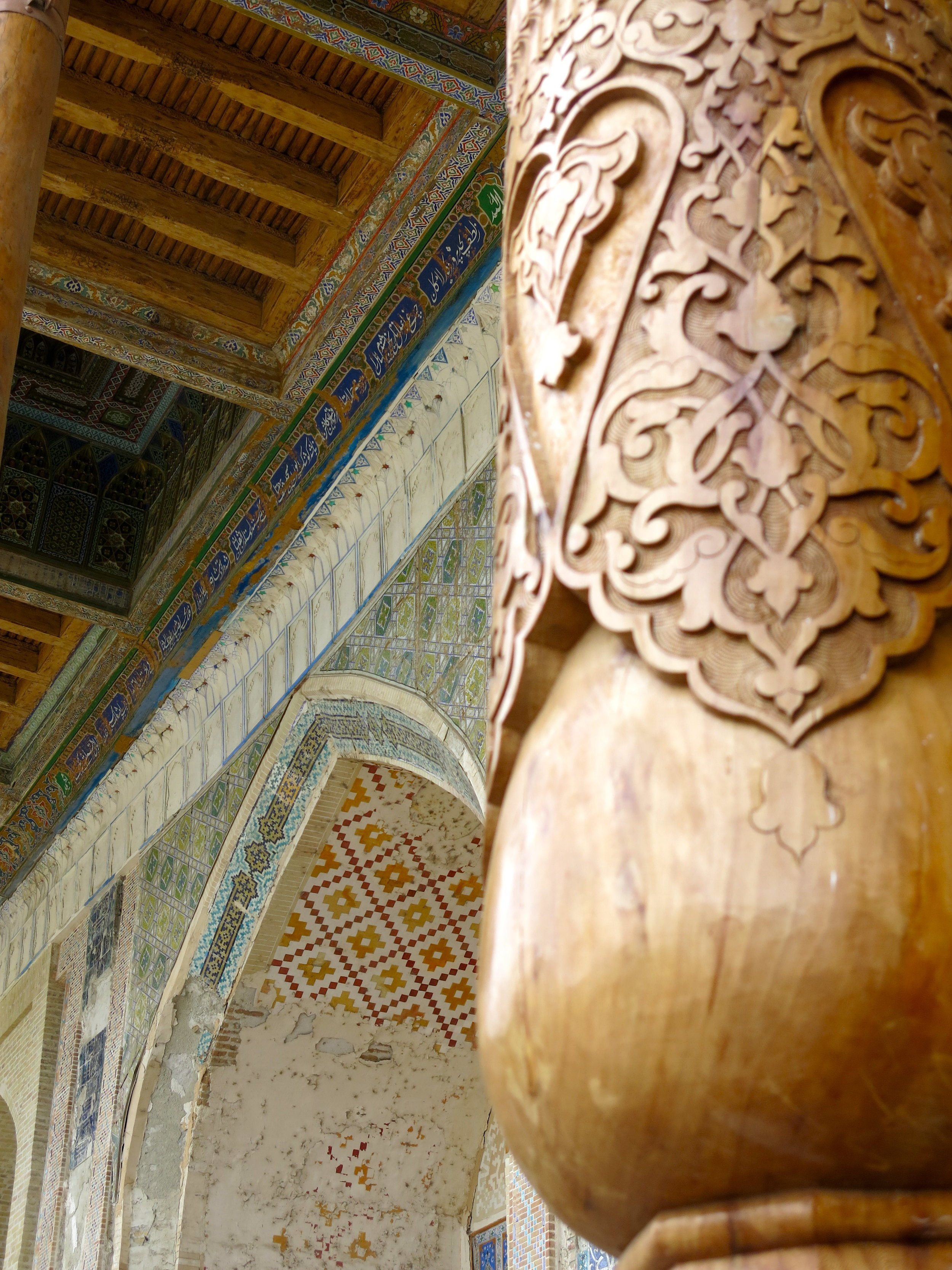 Fantastic carvings at the base of the wooden pillars