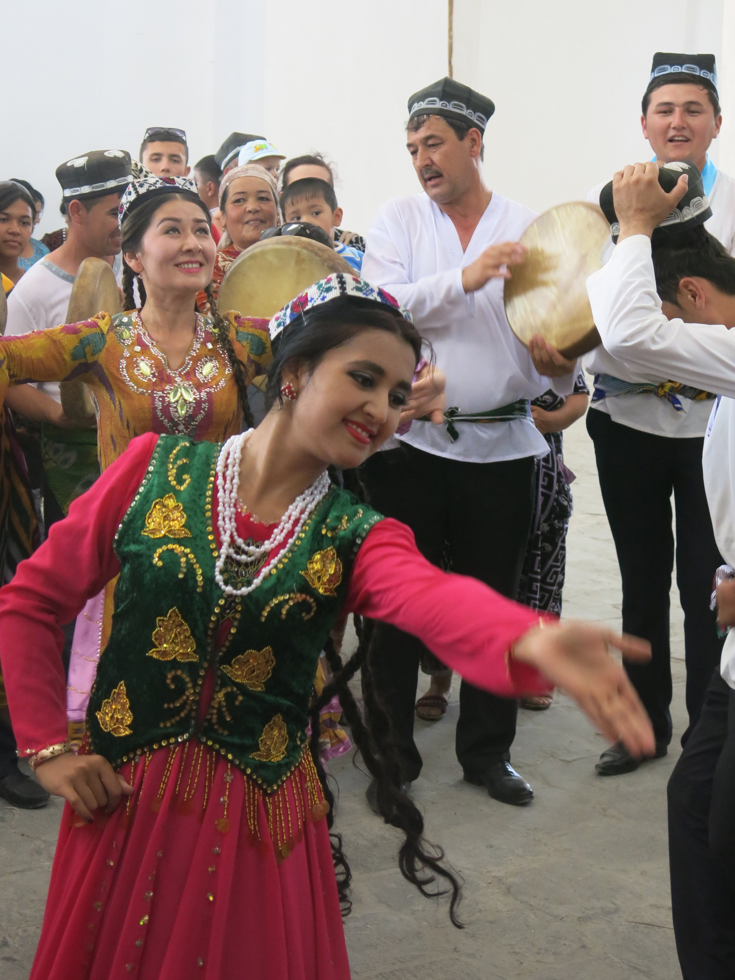 Local women performing dances inside a trading dome