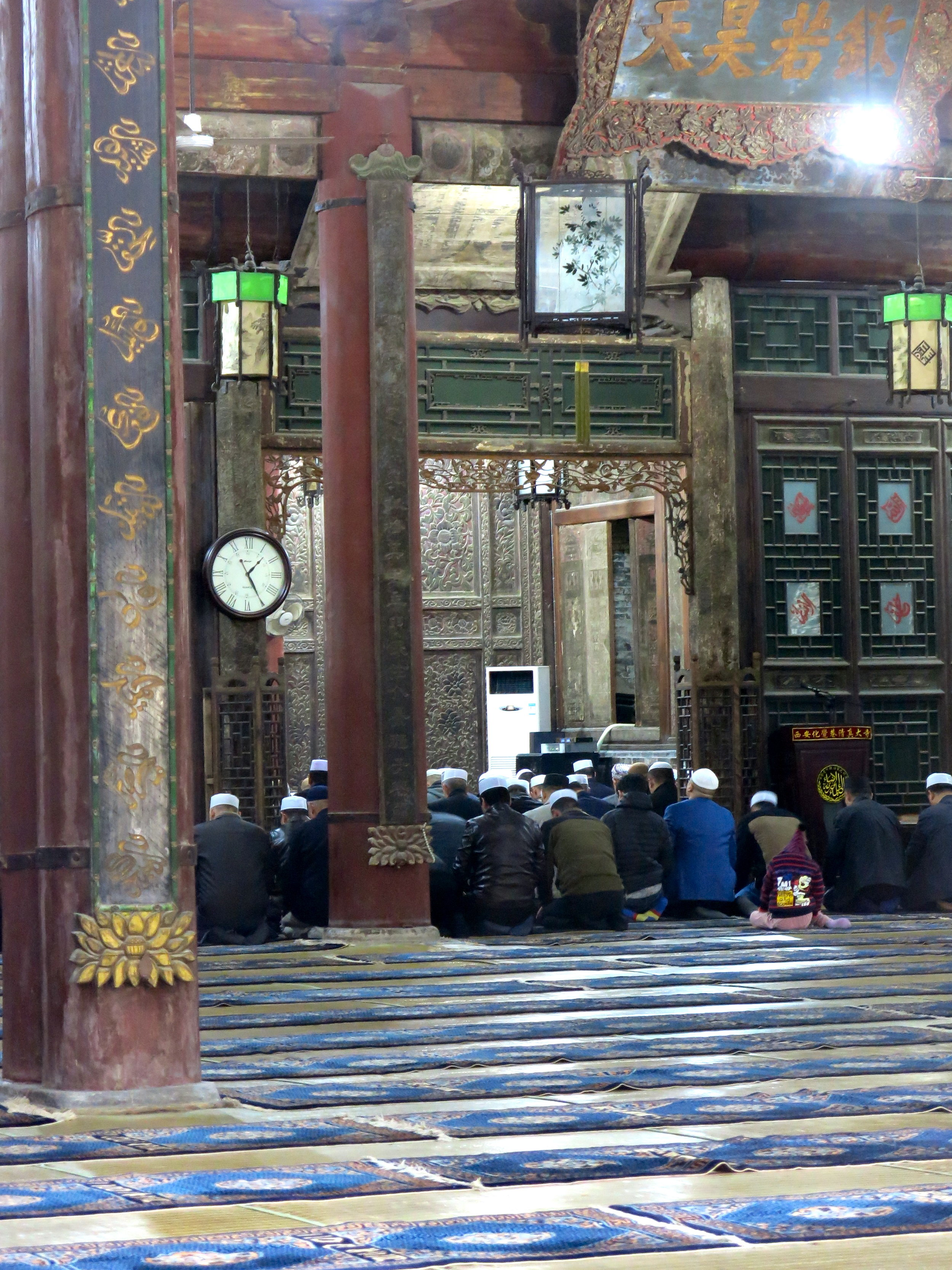 Hui men praying in the direction of Mecca in the mosque