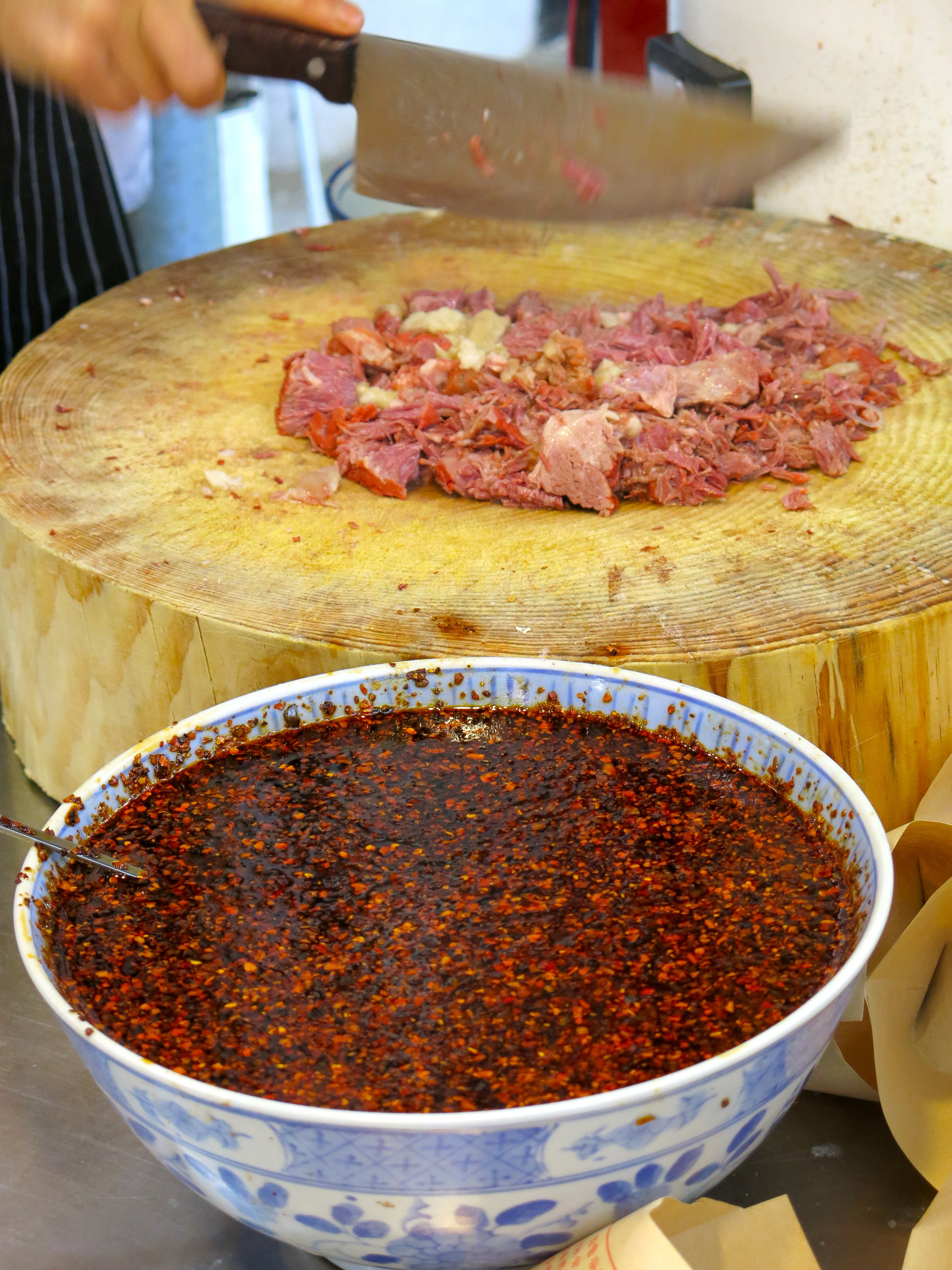 Roujiamo is made of minced meat and spices stuffed in a bread