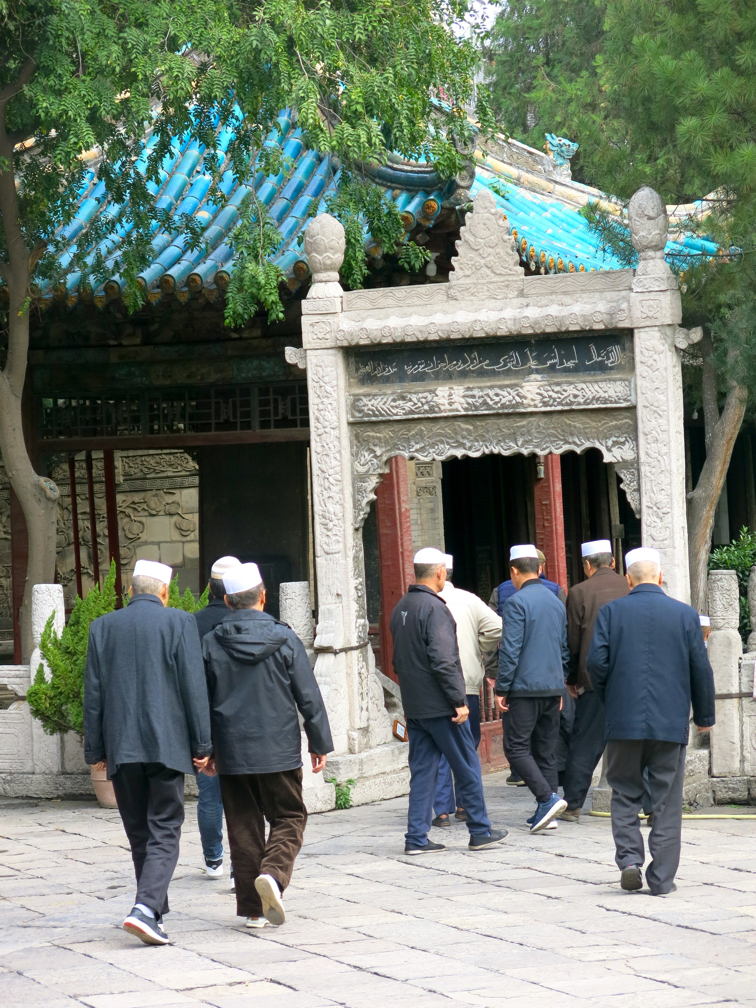 Men from the Muslim Hui community leaving the great mosque