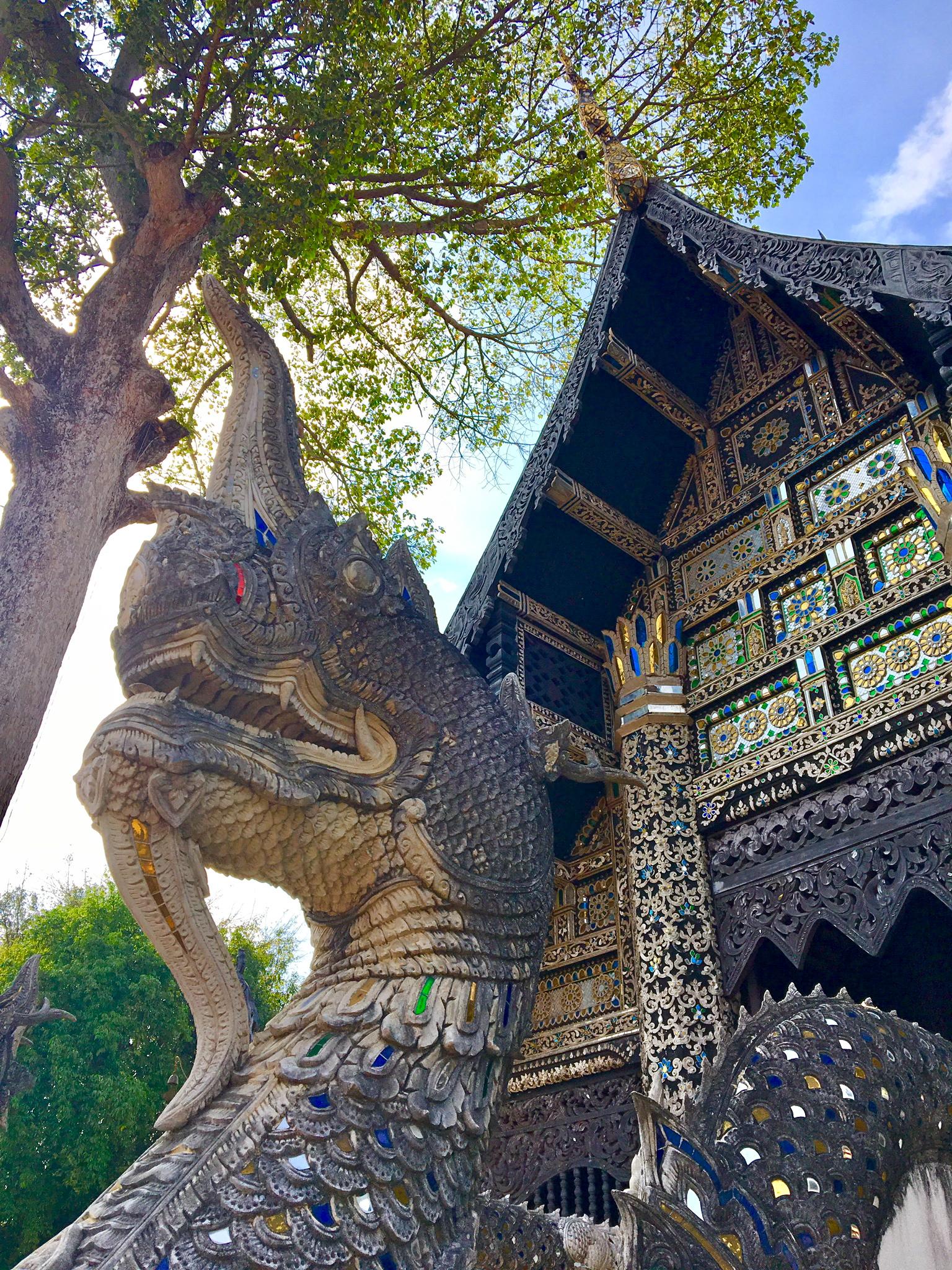 Naga guarding a wooden temple at the Wat Chedi Luang