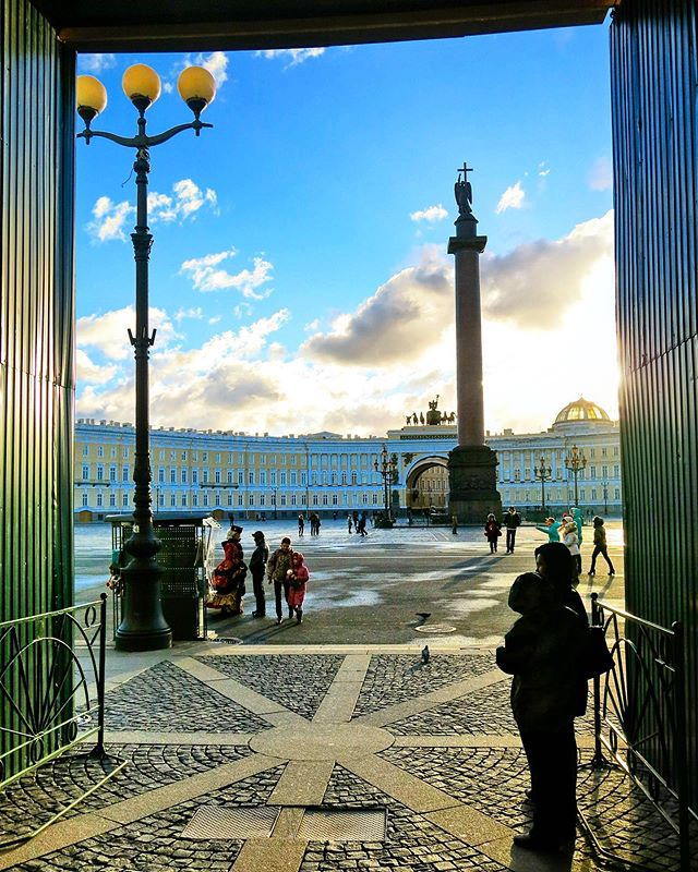 Walking out of the Winter Palace, the residence of Russian Tsars in the heart of Saint-Petersburg. . The palace now hosts the Hermitage Museum, one of the largest in the world. . This is mid-day in November, and it feels like sunset.