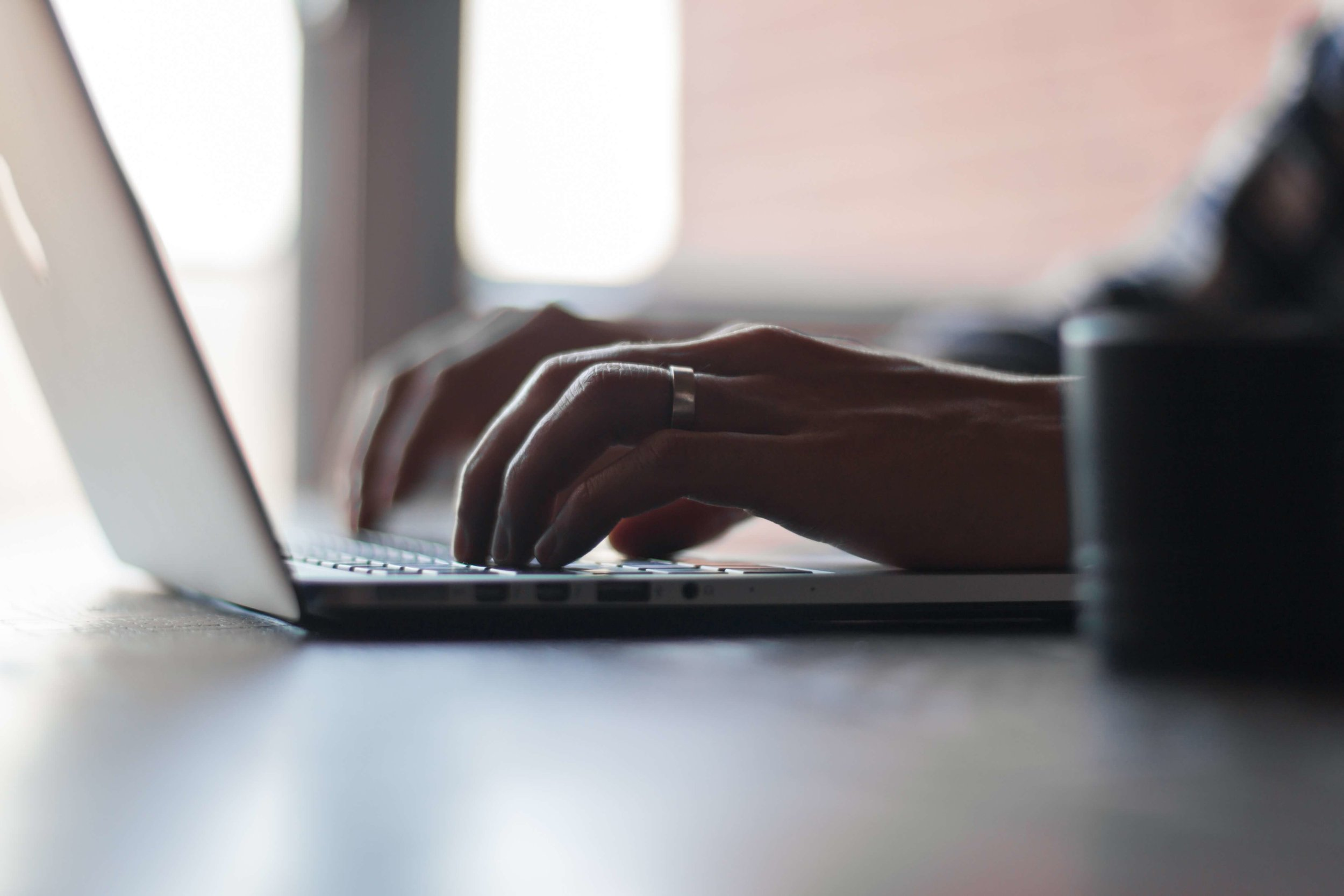 Copywriting services UK hands to the keyboard