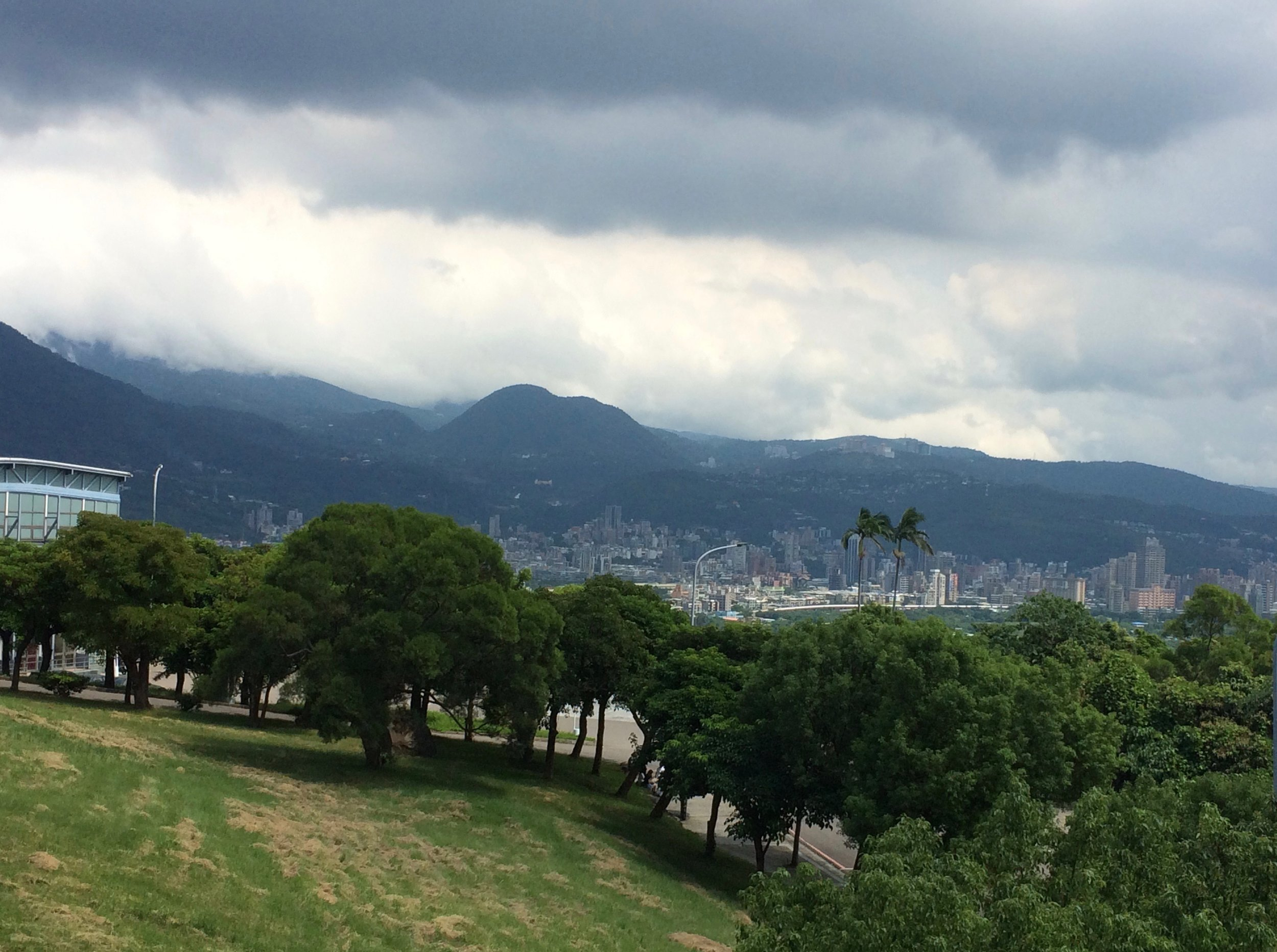 Looking out from the Guest House toward misty mountains and parts of extended New Taipei City