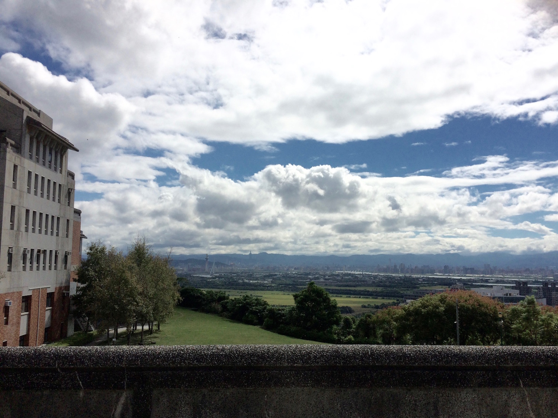 The peaceful view across Guandu Plain toward Taipei's towers and teeming streets