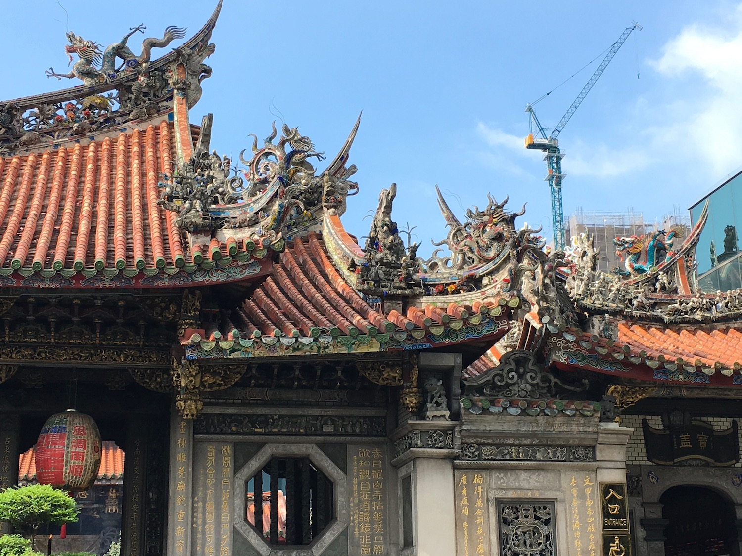 Lively Longshan Temple, established in 1738, surrounded by glass towers and new construction