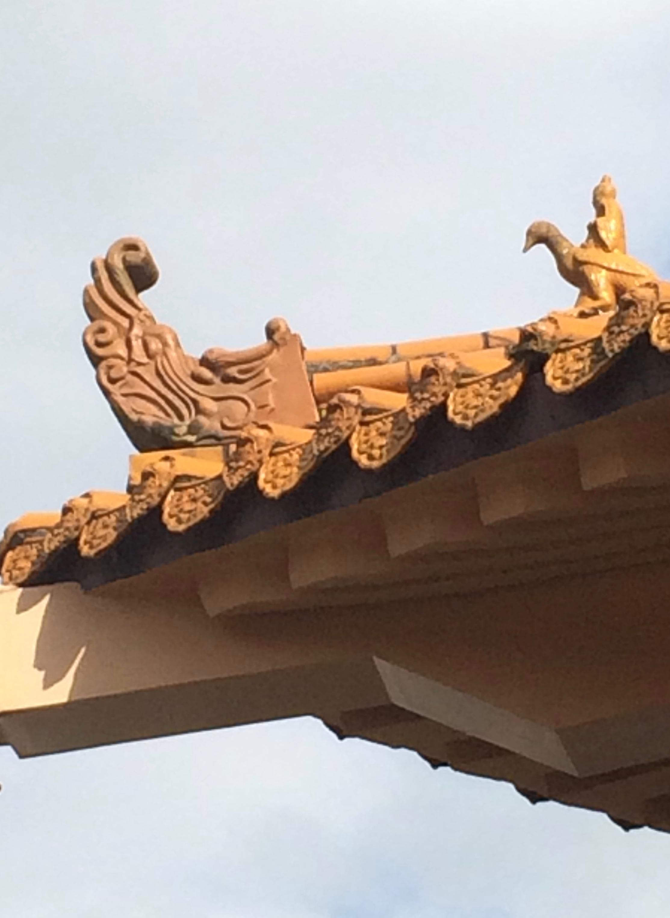 Single roof charm of man riding elegant bird at Maokong Temple