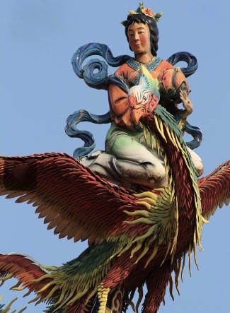 Professional detail photo shows shard-style phoenix combined with modeled-and-painted heavenly figure