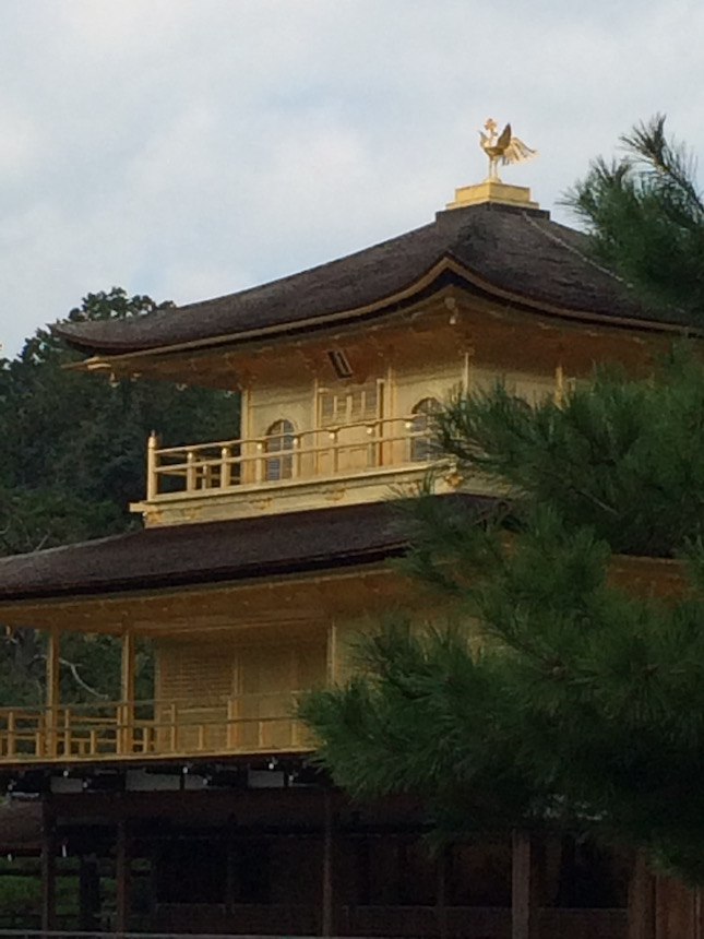 Phoenix finial atop the brilliant gold-leafed Temple of the Golden Pavilion, Kyoto