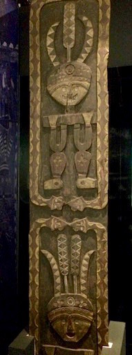 Paiwan wood carving showing related patterns of hundred-pace snake and eagle feathers