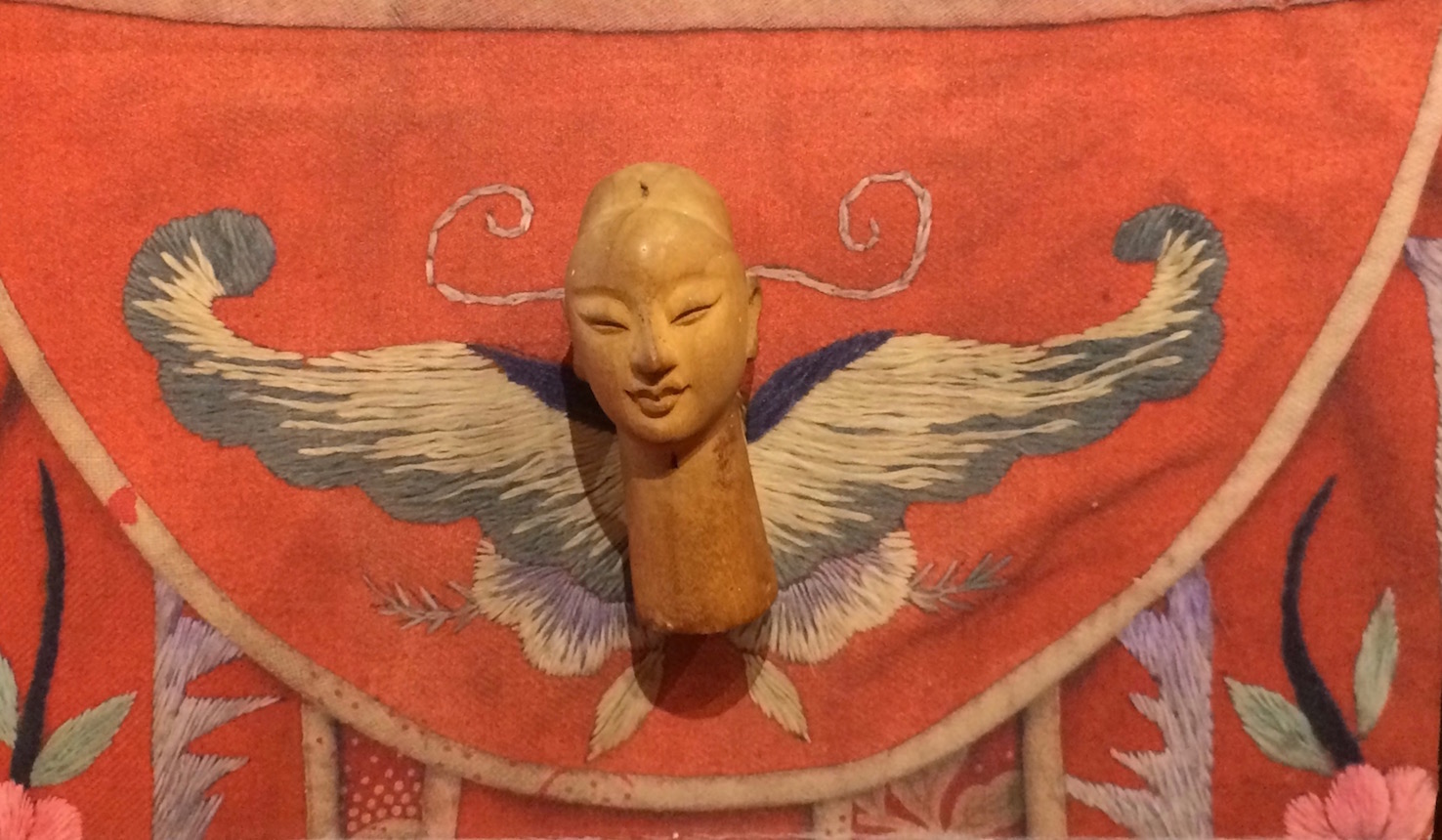 Winged figure featuring antique embroidery at the Puppet Museum in Taipei