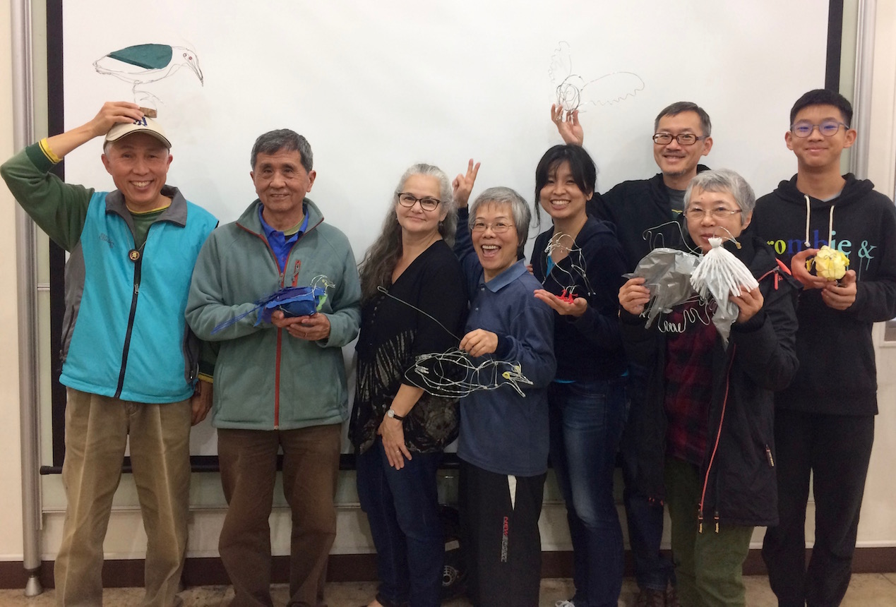 Volunteers at Guandu Nature Park display their wire-and-mixed-media bird sculptures