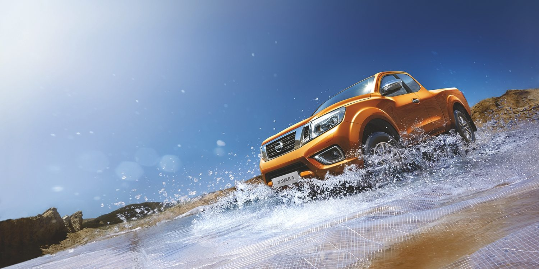 Nissan Navara Orange at the beach