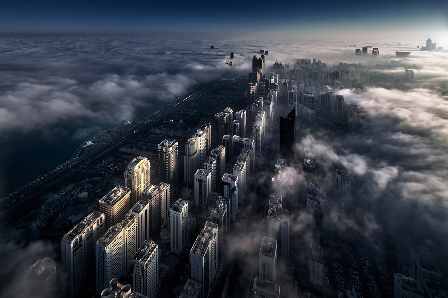 Abu Dhabi's busy downtown at sunrise, photographed from the 98th floor of a tallest structure in the Capital of the UAE