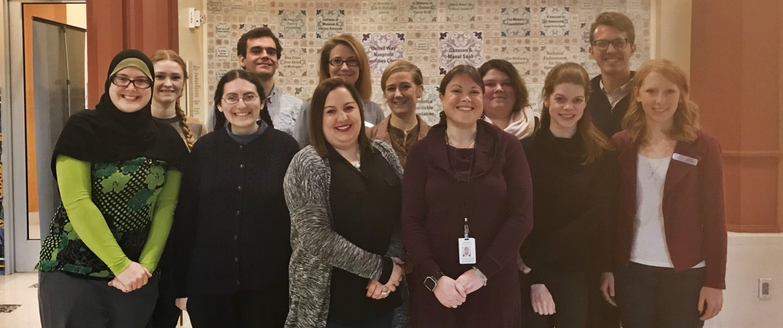 Twelve MACA members stand for a picture during a meeting in November 2017.