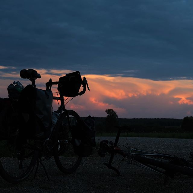 Even my bike enjoys the sunsets. Found this wild camping spot just off the #transamericatrail in Niangua, Missouri. It was so hot and humid that we awoke with all our belongings soaking wet, but it was worth it for the sunset. . . . . . . . . . . #cyclingshots #cycle #touring #training #cycletouring #cycling #bikepacking #ilovecycling #cyclingphotos #bikewander #cyclinglove #roadcyclinglove #biketour#biketravel#cicloturismo#adventurecycling#outsideisfree#wanderlust#fromwhereiride #exploremore#adventureiswaiting#adventurebybike #slowtravel#travelbybike#rideyourbike#roadcycling #bicyclecafe