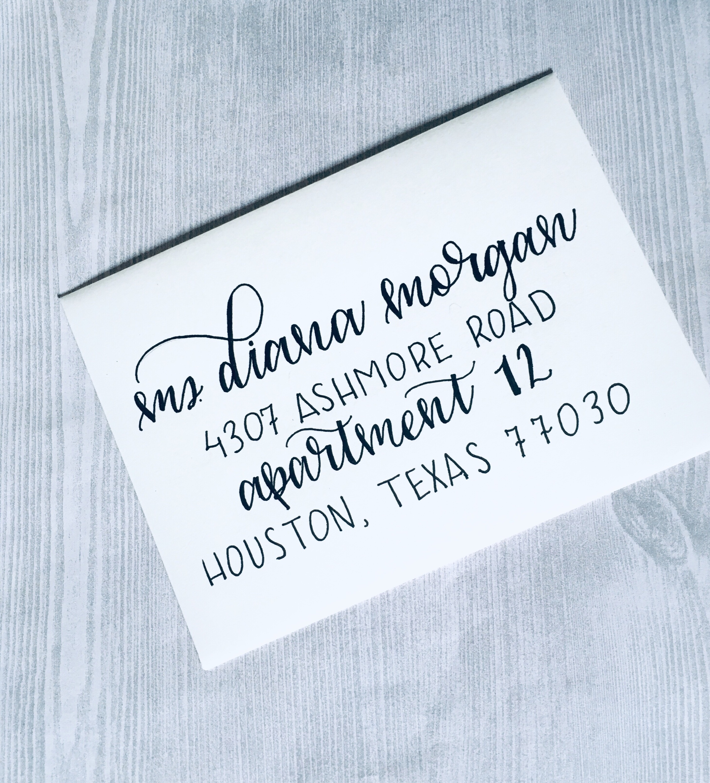 In this envelope I combined both a script font in faux calligraphy and a Sans serif style.