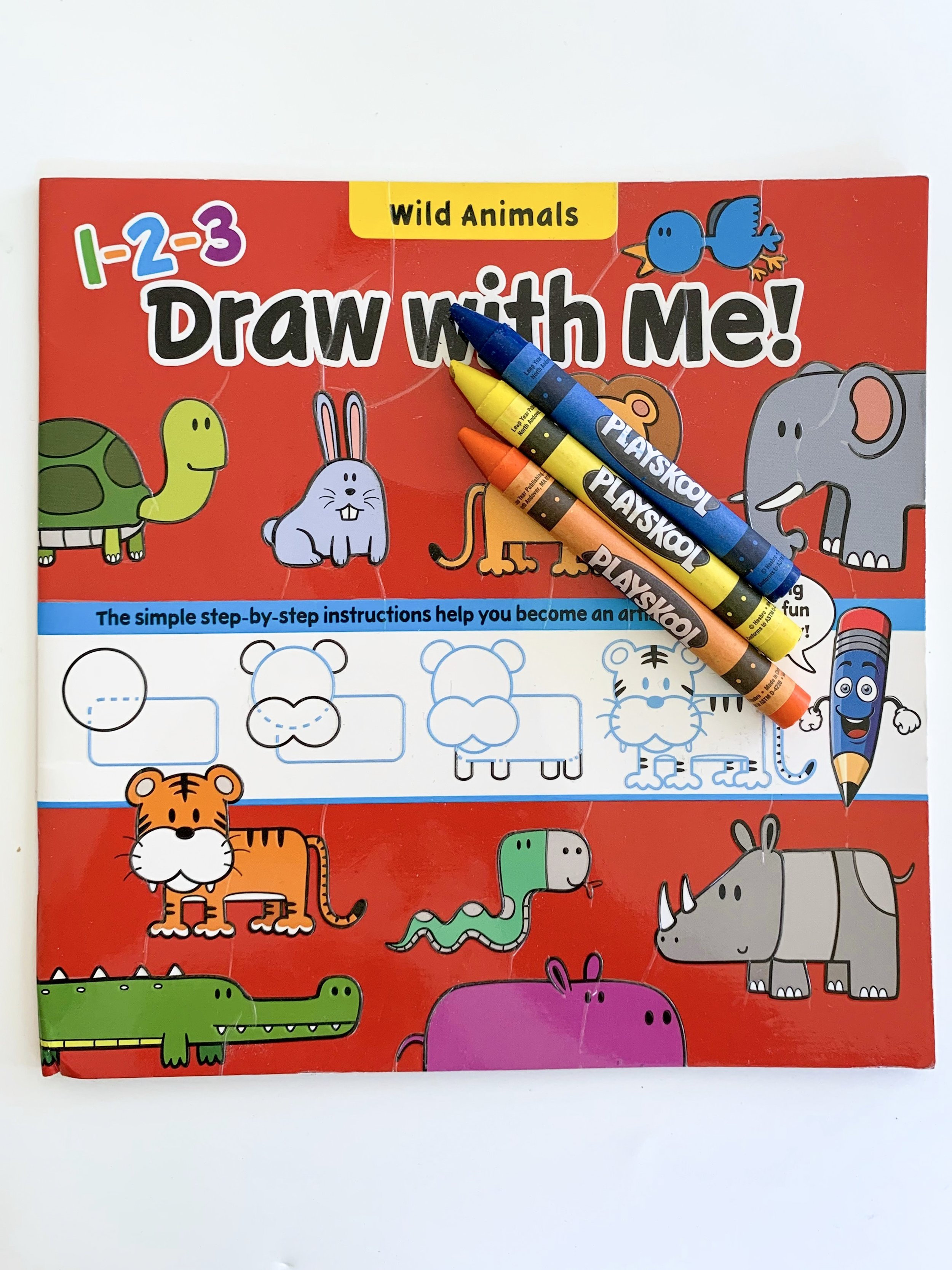 Coloring book and crayons some of the must haves for traveling internationally with a toddler