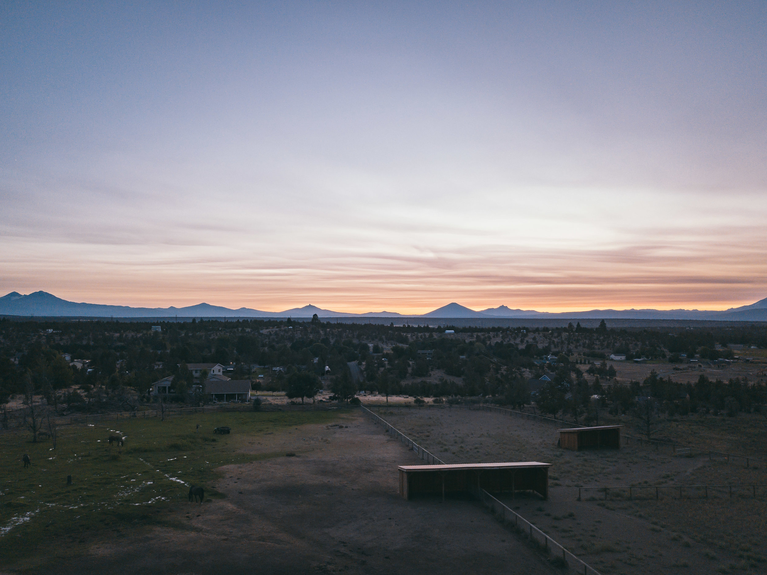 The horses get spoiled with the best sunsets, over the Cascade Mountains.