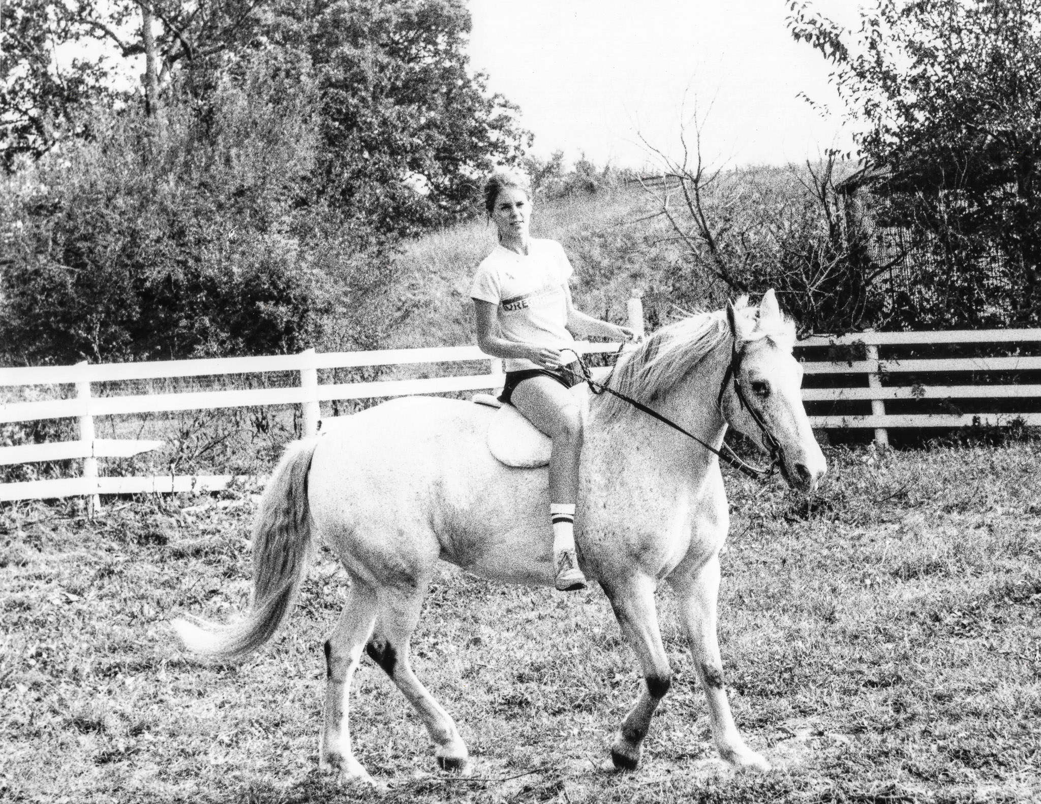 Young Melanie on her first horse, Speck.